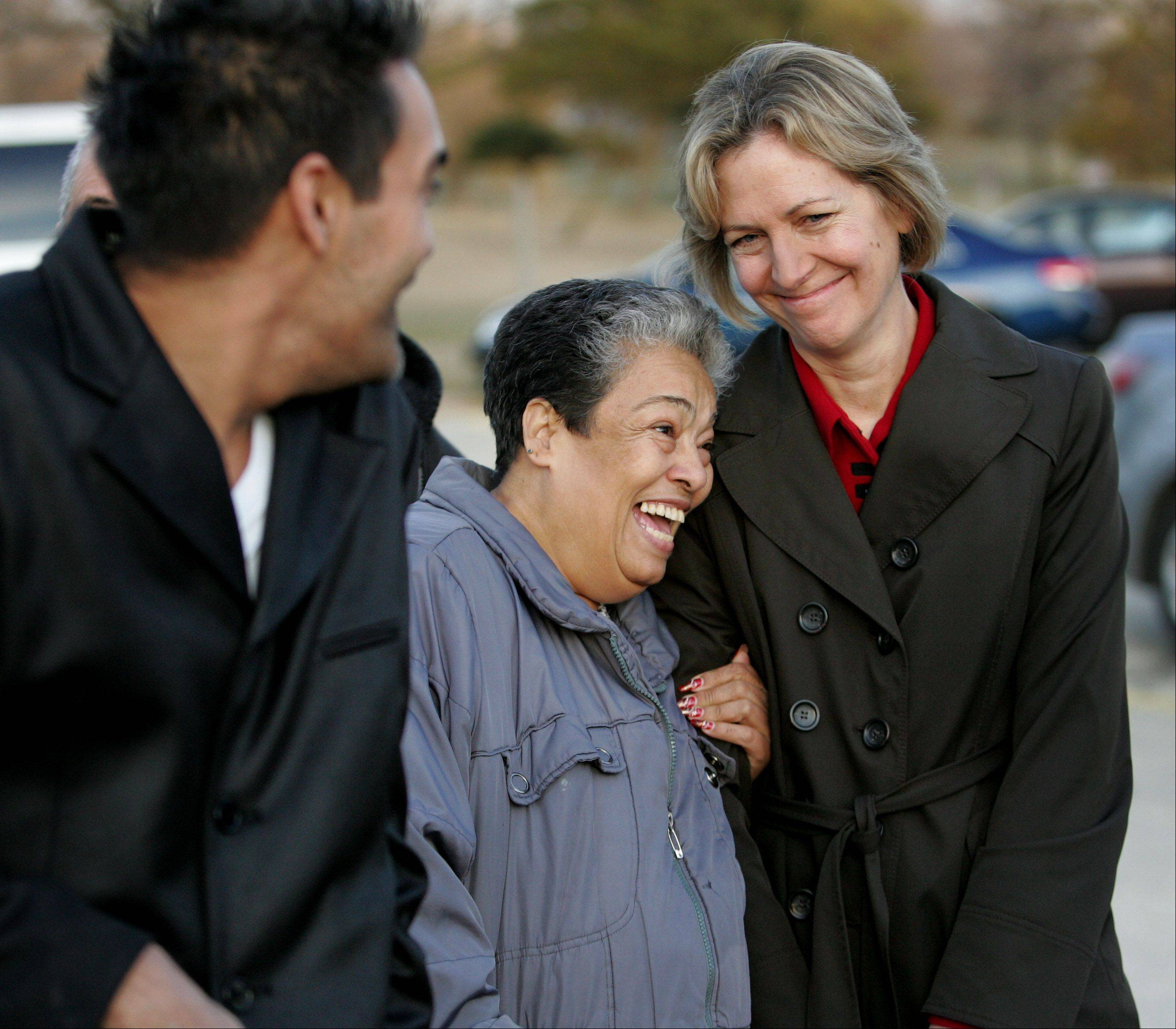 Carmen Rivera gives gives Judy Royal, an attorney with the Center on Wrongful Convictions, a hug as they await the release of Rivera's son Juan Rivera at Stateville Correctional Center in Crest Hill.