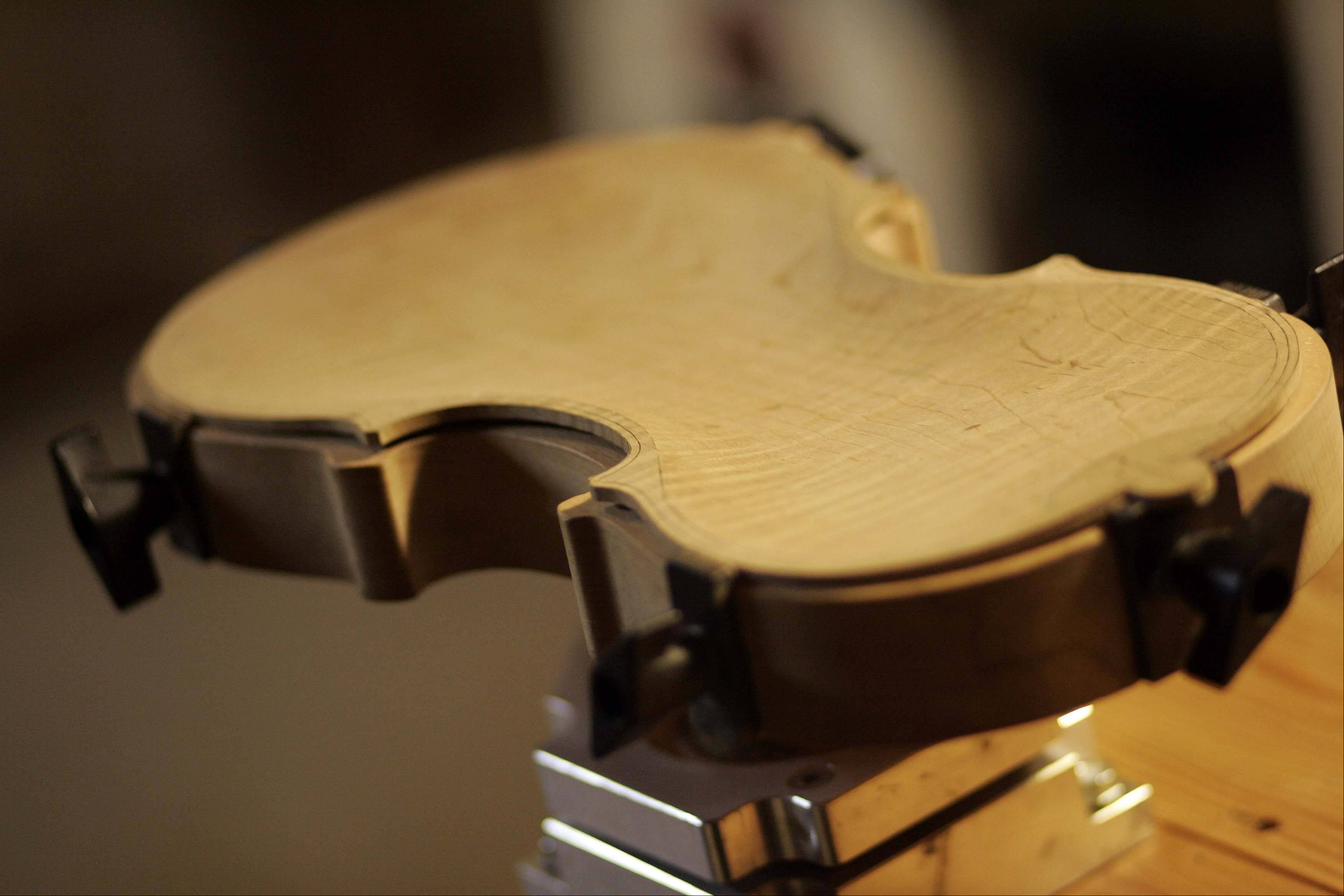 A unfinished violin is ready for more work in Brunkalla's workshop.