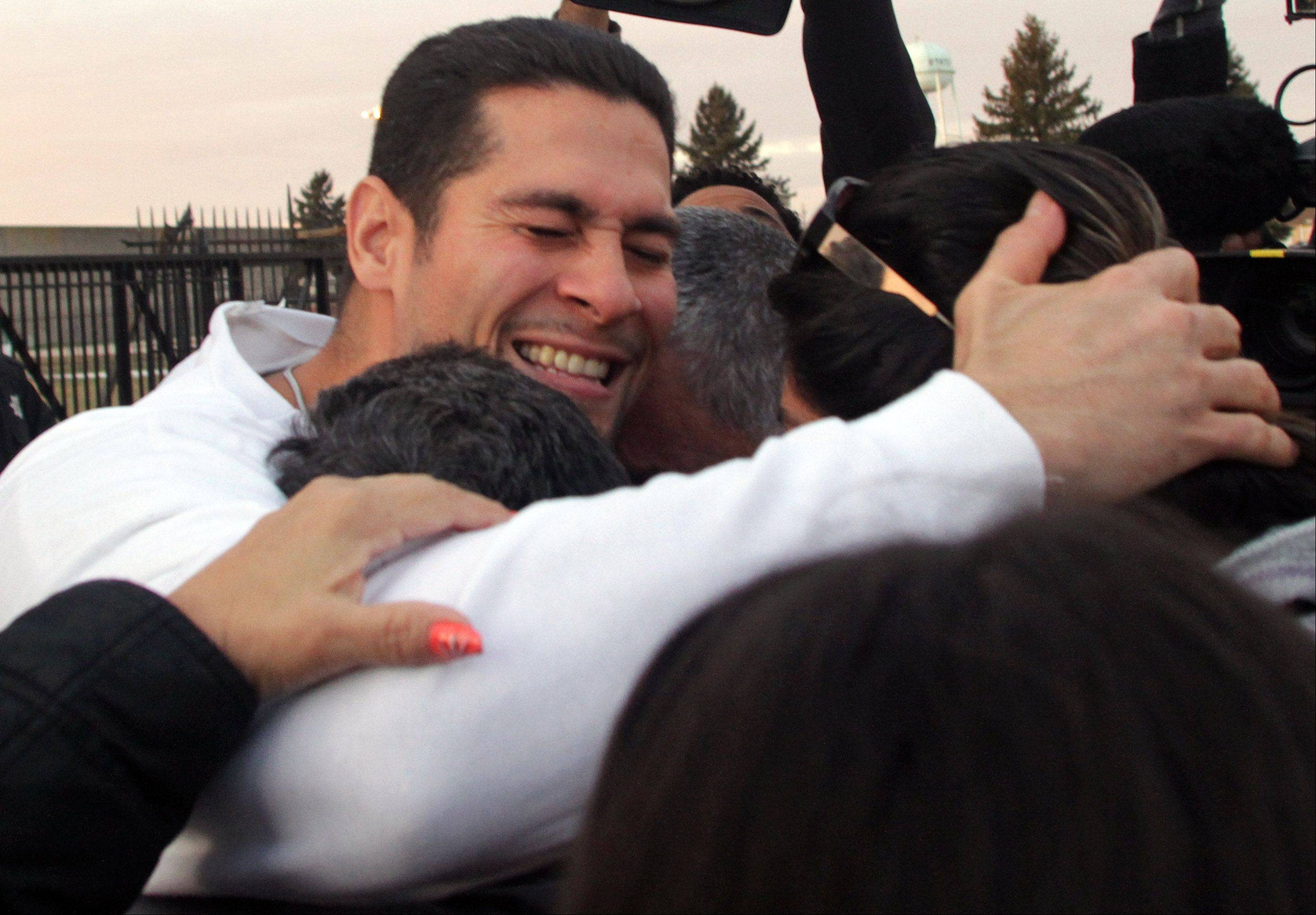 Juan Rivera is surrounded by his family after he is released from Stateville State Prison on Friday. An appellate court ruling throwing out his 1992 conviction for rape and murder.