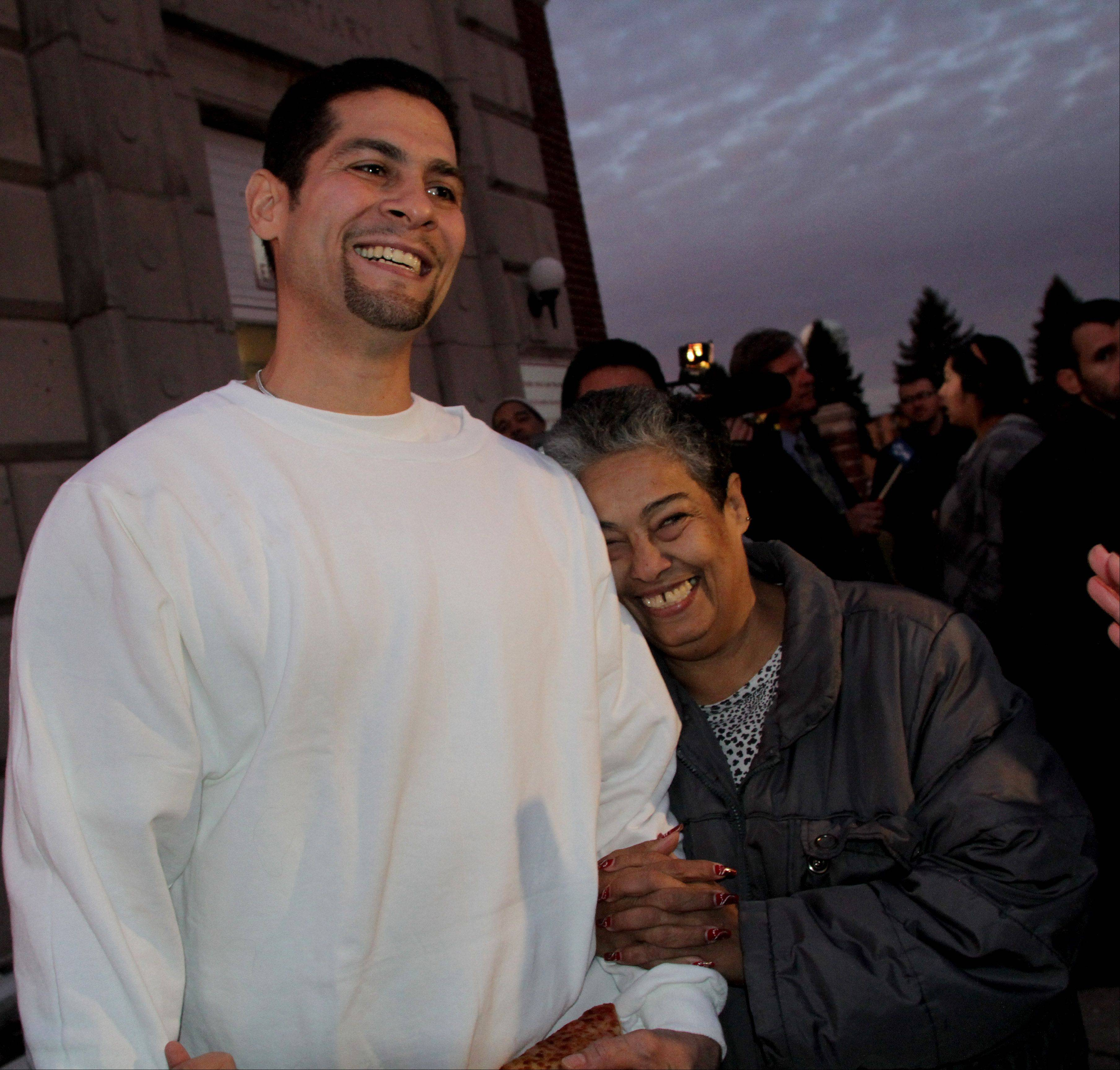 Juan Rivera is hugged by his mother Carmen Rivera of Waukegan after he is released from Stateville State Prison on Friday. An appellate court ruling throwing out his 1992 conviction for rape and murder.