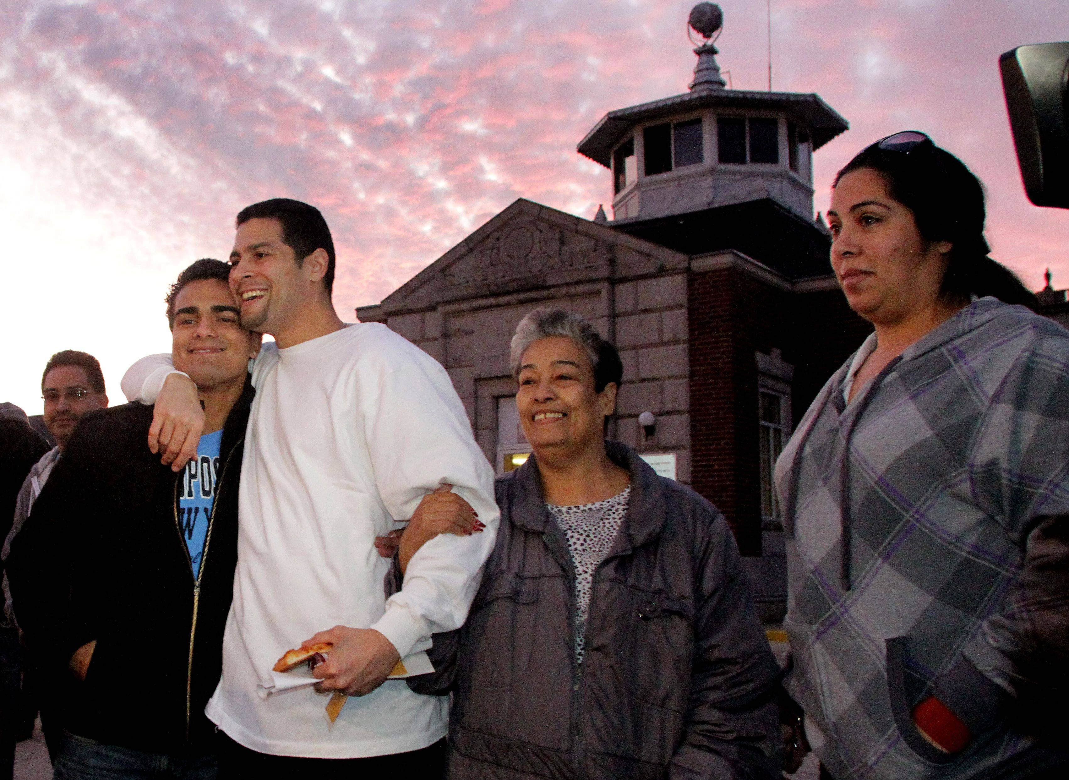 Juan Rivera is released from Stateville State Prison on Friday after an appellate court ruling throwing out his 1992 conviction for rape and murder. On the left is his nephew John Michael Diaz, on the right is mother Carmen Rivera and his sister Rebecca Leon.