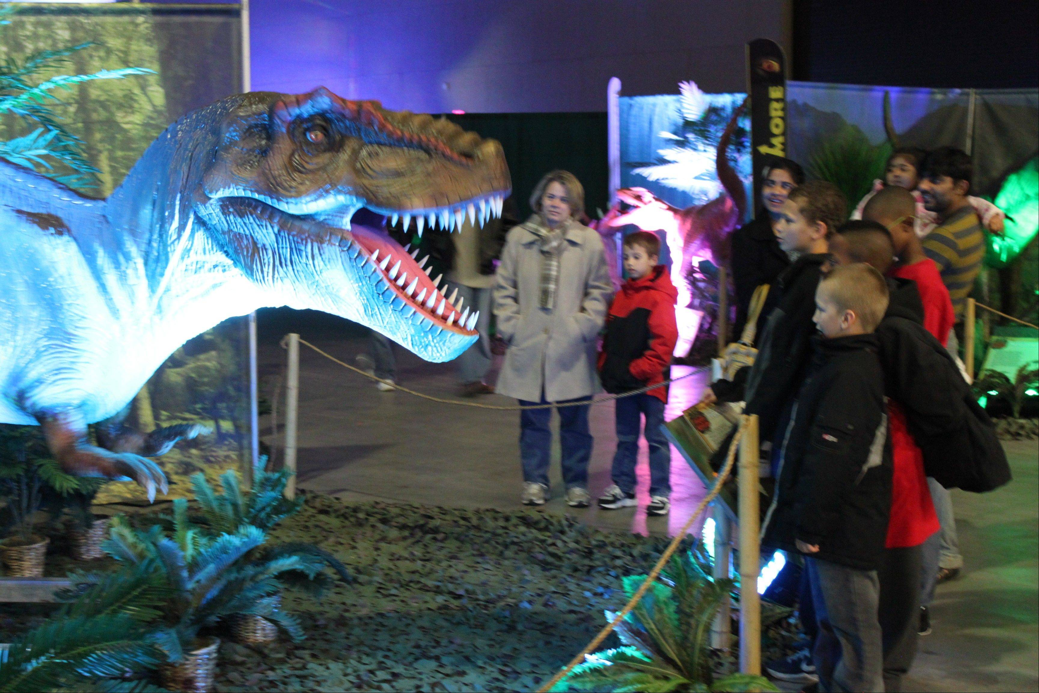 "Mechanized dinosaurs are just part of the fun at the interactive exhibit ""Discover the Dinosaurs"" starting this weekend at the Donald E. Stephens Convention Center in Rosemont."