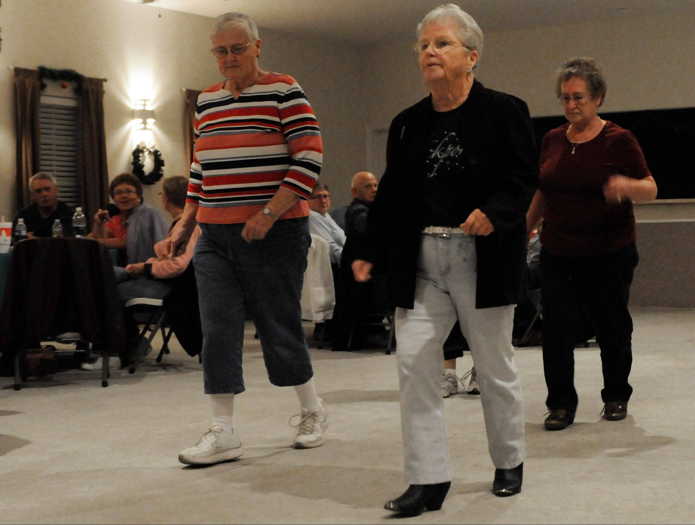 Phyllis Hampton, center, leads a group of dancers at the Drifters Resort community Hall in Rockport, Texas.