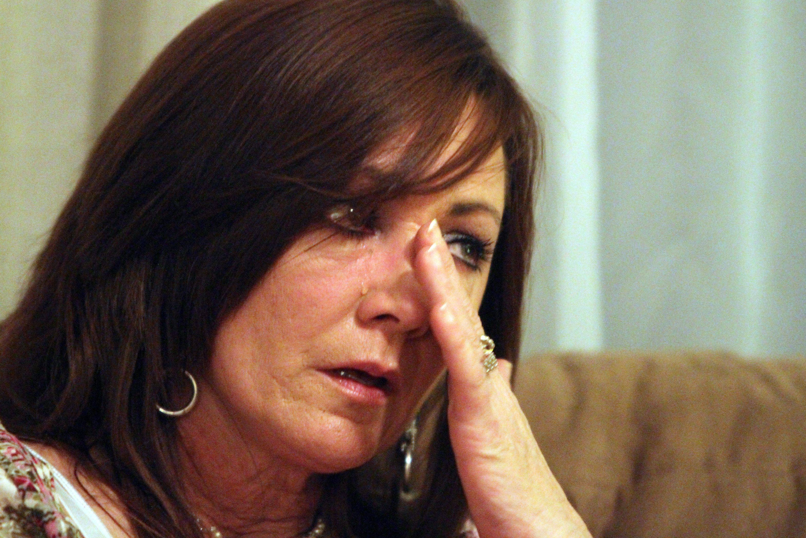 Nancy Kalinowski wipes a tear after talking about her daughter, Holly Staker, who was murdered in 1992.