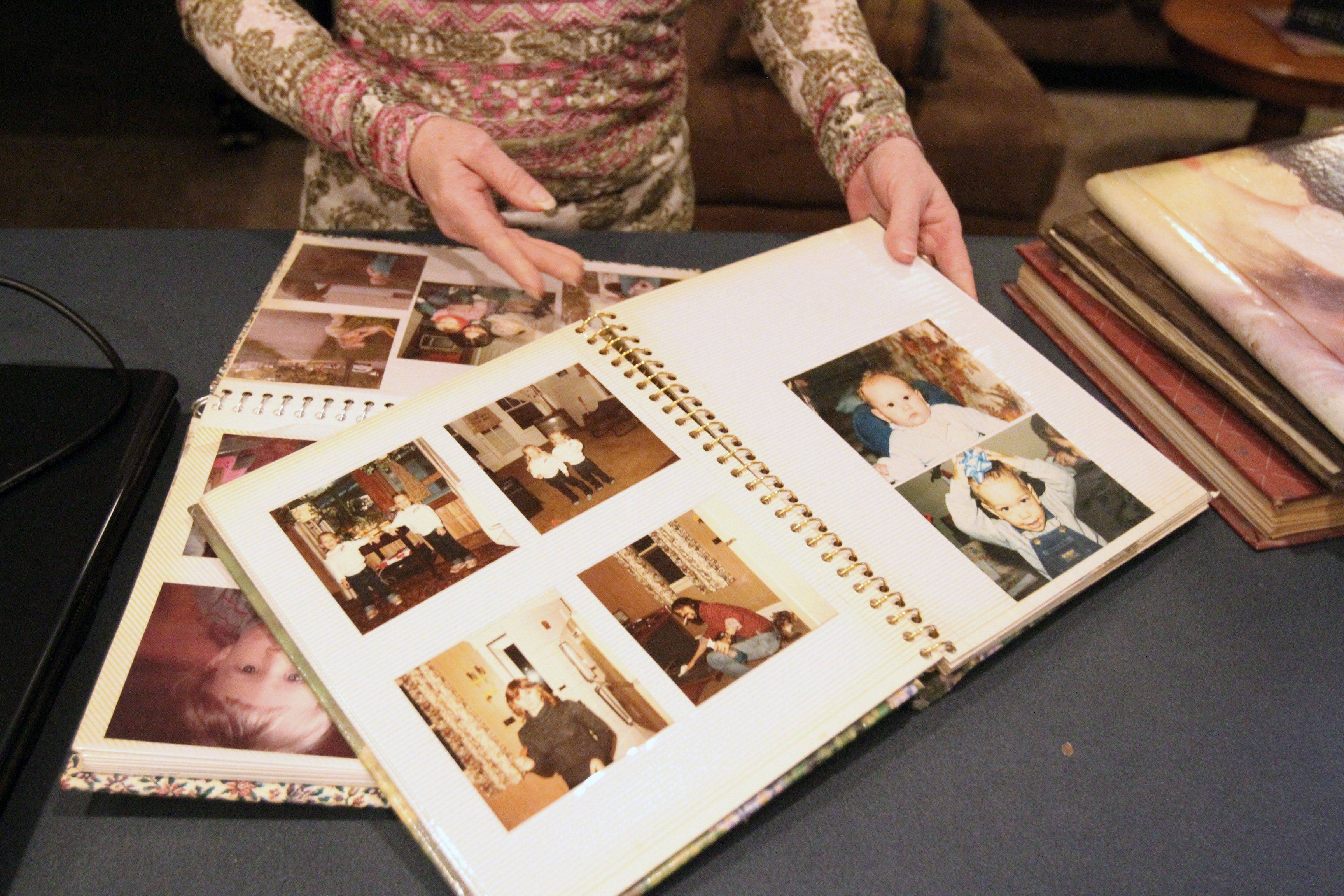 Nancy Kalinowski on Friday shows albums filled with photographs of her daughter, Holly Staker, who was murdered in 1992.
