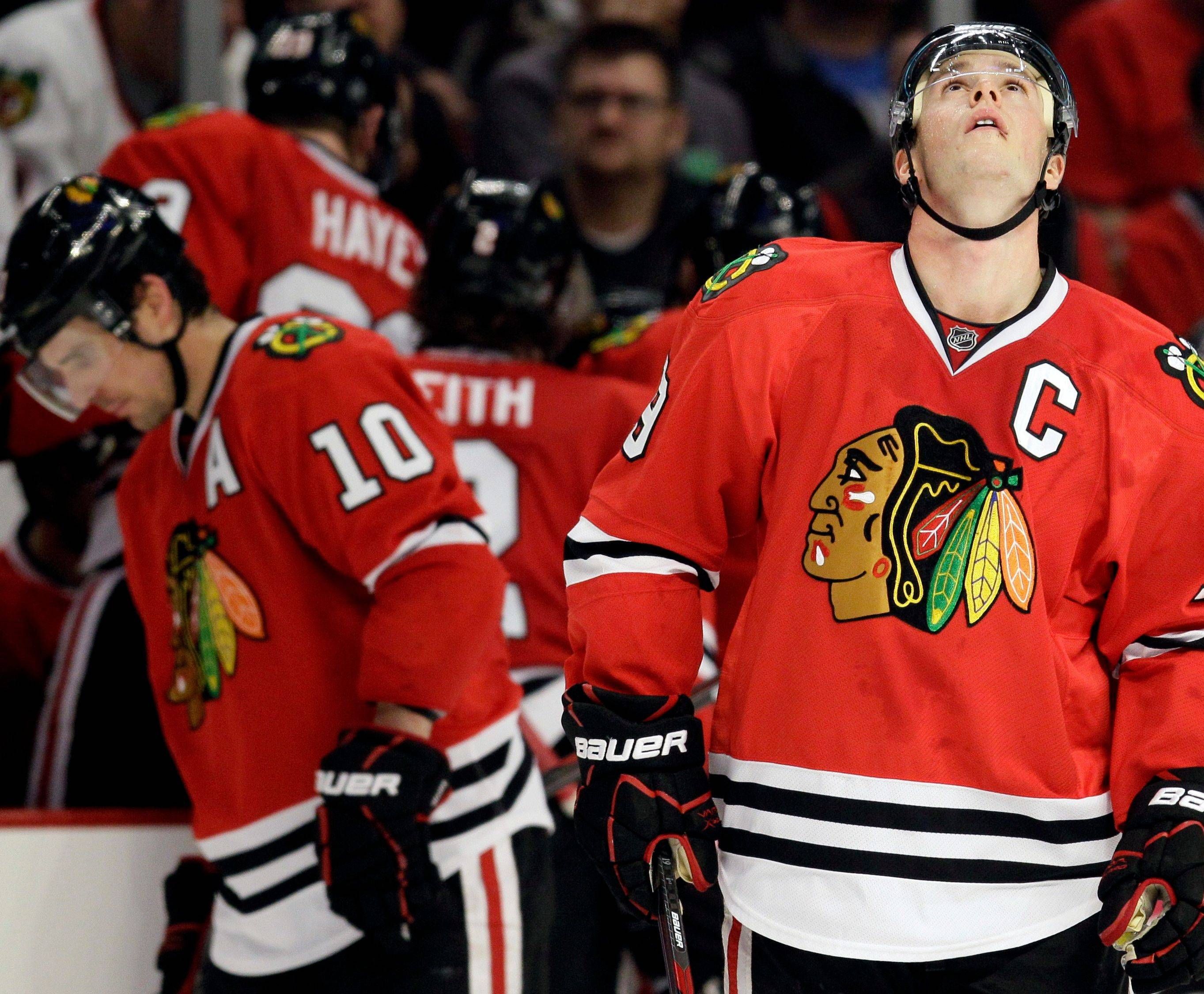Blackhawks Jonathan Toews, right, and Patrick Sharp have reason to be concerned, but it's through no fault of their own.