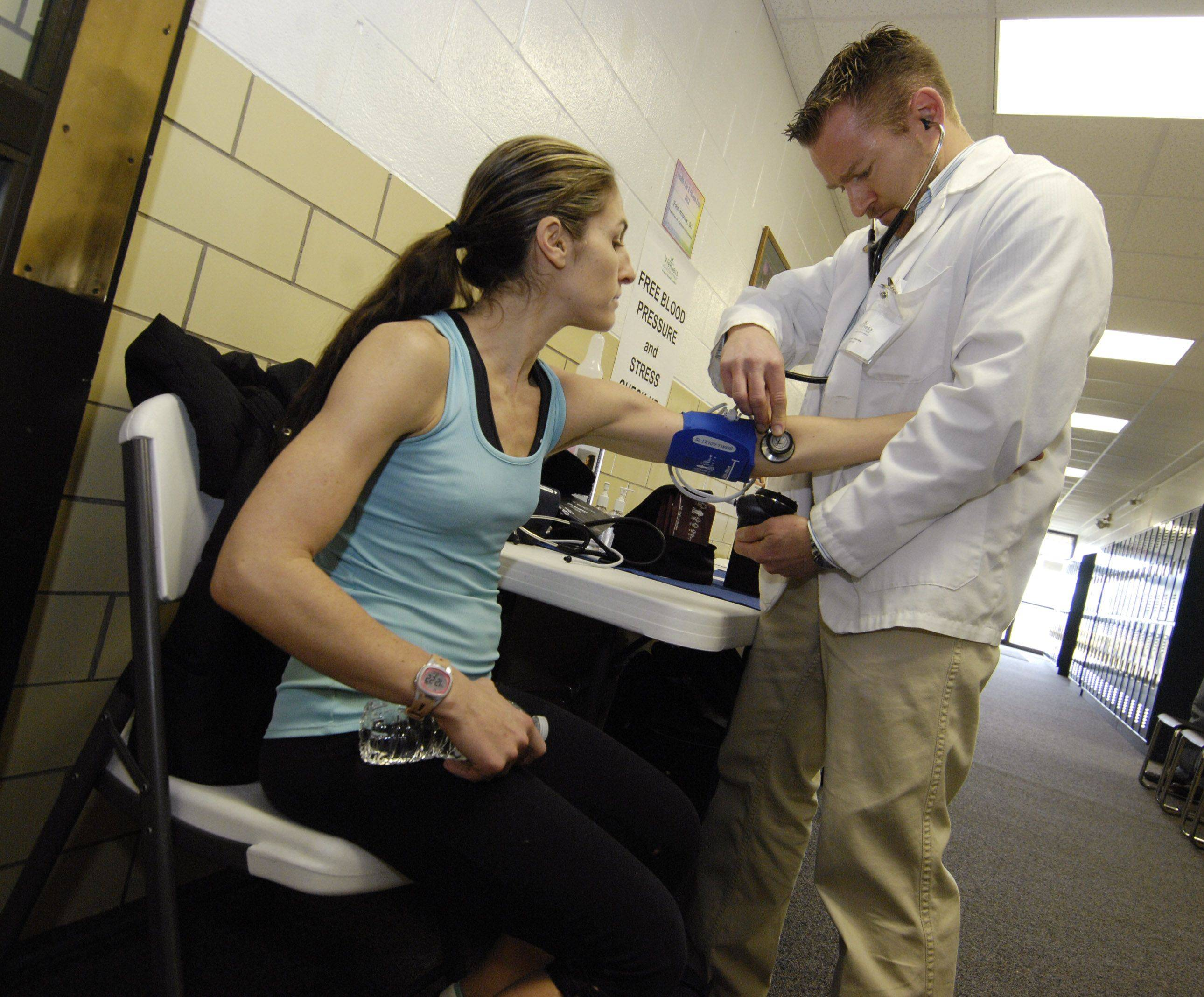 Marisa Bianco of Lombard receives a free blood pressure check from Dr. John Wascow during the 2012 Health Fair and Fitness Expo Sunday at the Sunset Knoll Recreation Center in Lombard.