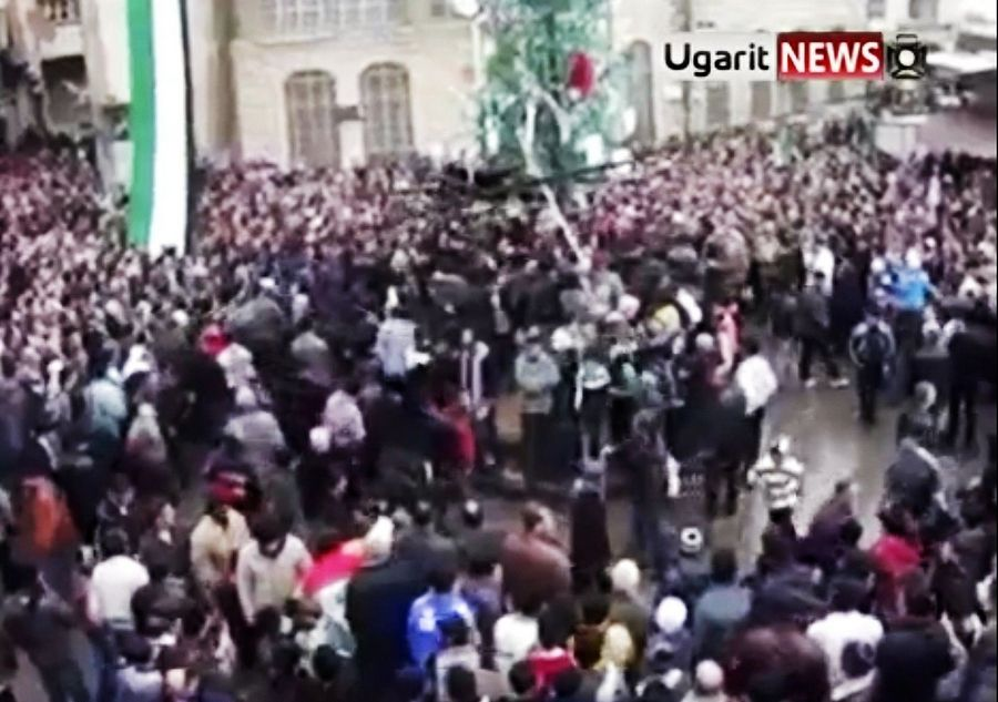 This image made from amateur video and released by Ugarit News purports to show Syrians attending a mass funeral Saturday in Damascus, Syria.