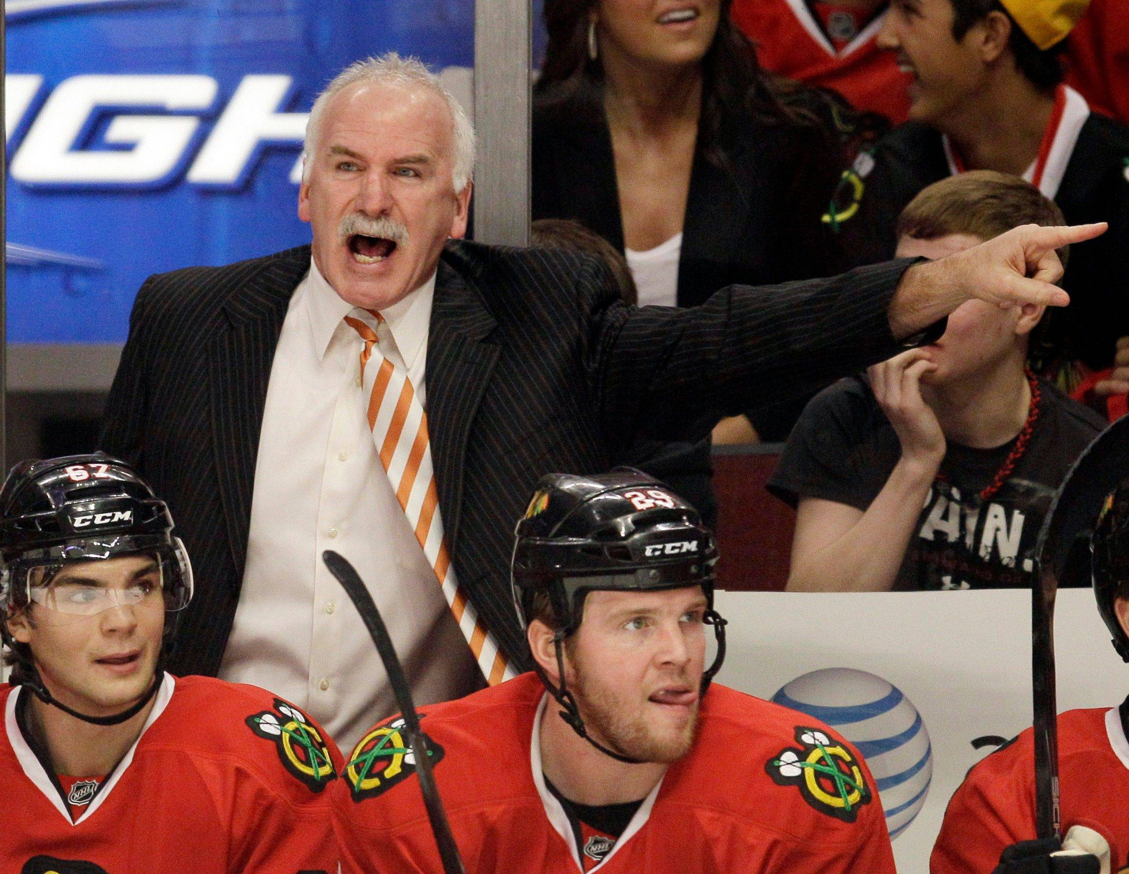Blackhawks coach Joel Quenneville reacts to a call during the first period of Sunday night's overtime loss to the Red Wings.