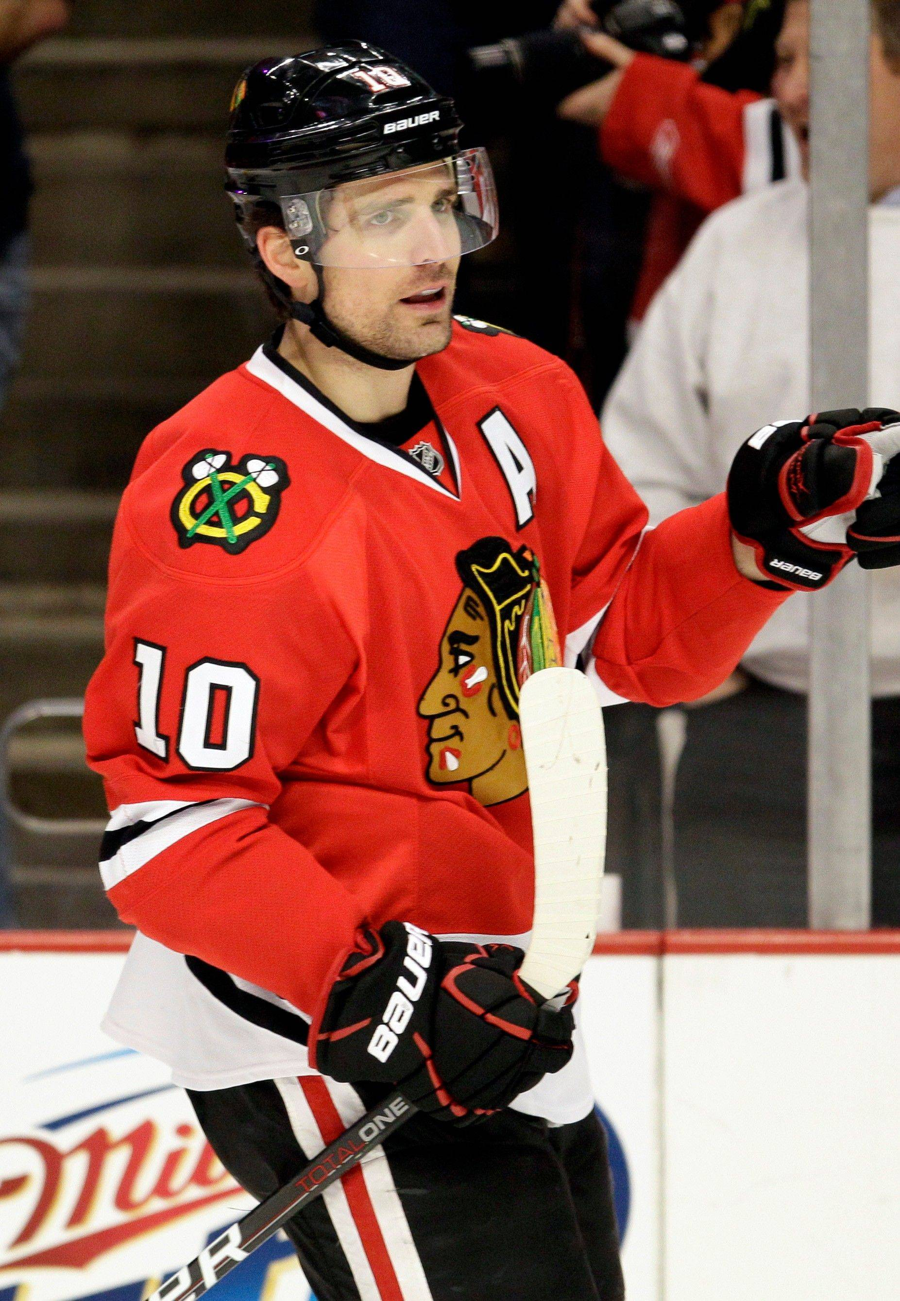 The Blackhawks' Patrick Sharp points after scoring a goal during the first period Sunday against the Red Wings.