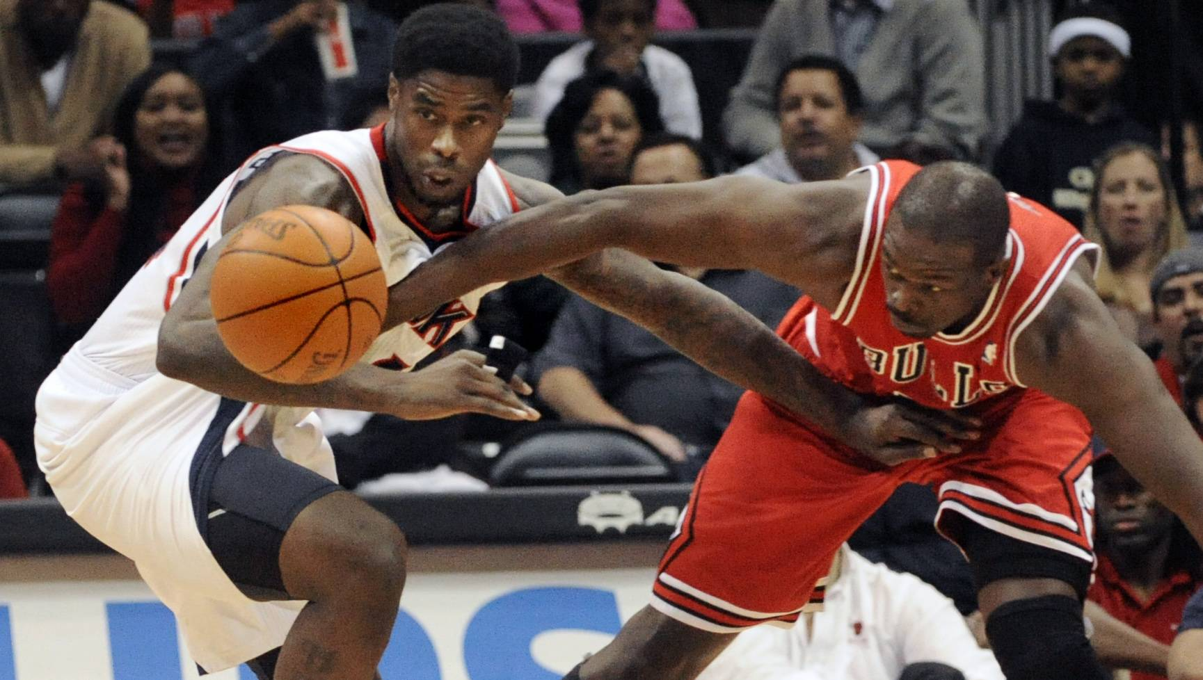 Atlanta Hawks forward Marvin Williams, left, battles for a loose ball Saturday with Chicago Bulls forward Luol Deng during the first half of an NBA basketball game in Atlanta.