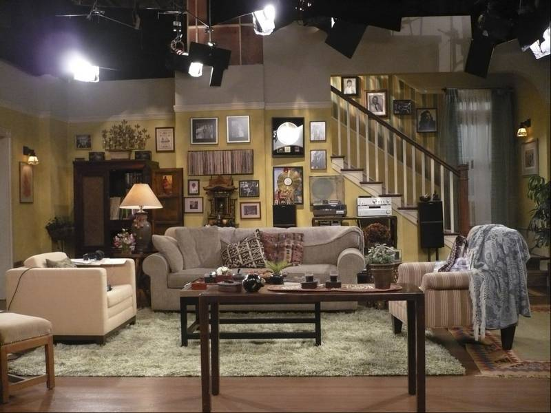 Set decorators use decor to flesh out characters for Rooms to go living room set with tv