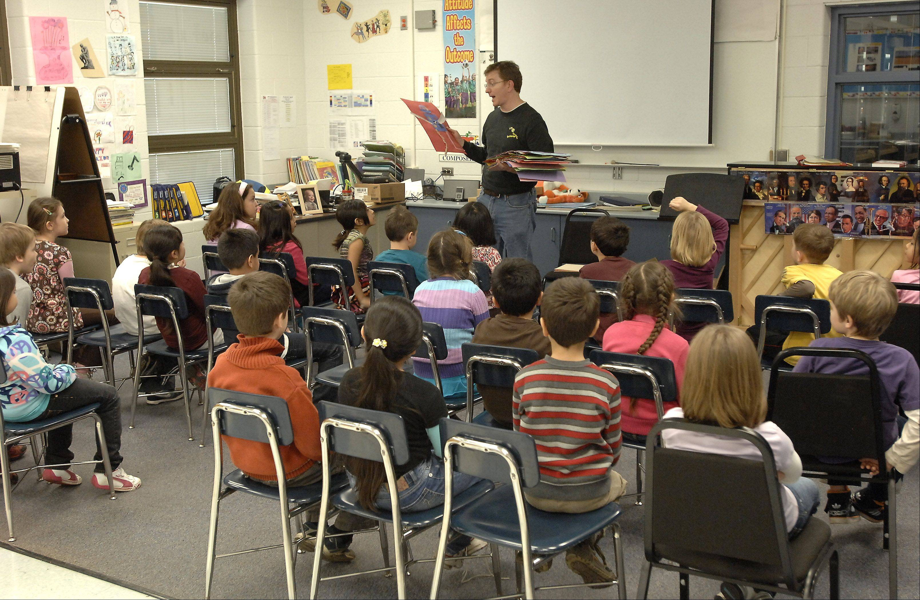 Fine arts teacher Andrew Brand works with 29 students during his class at Robert Frost Elementary School in Mount Prospect. Overcrowding could cause him to teach in an art-in-a-cart system traveling to different rooms.