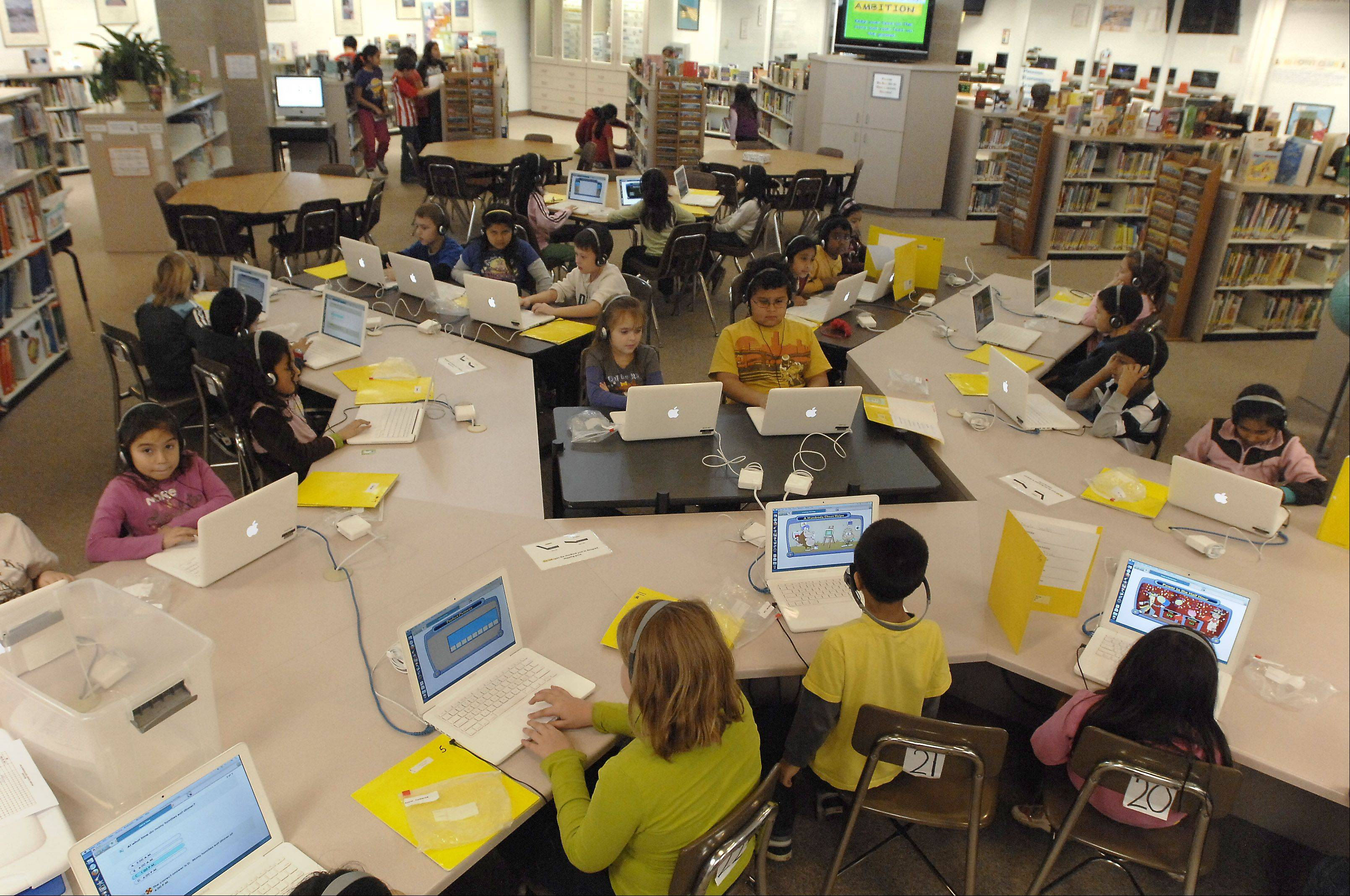 Desks and tables have been added to the learning resource center to accommodate more students at Robert Frost Elementary School in Mount Prospect. An unexpected rise in enrollment has led to overcrowding at the school.