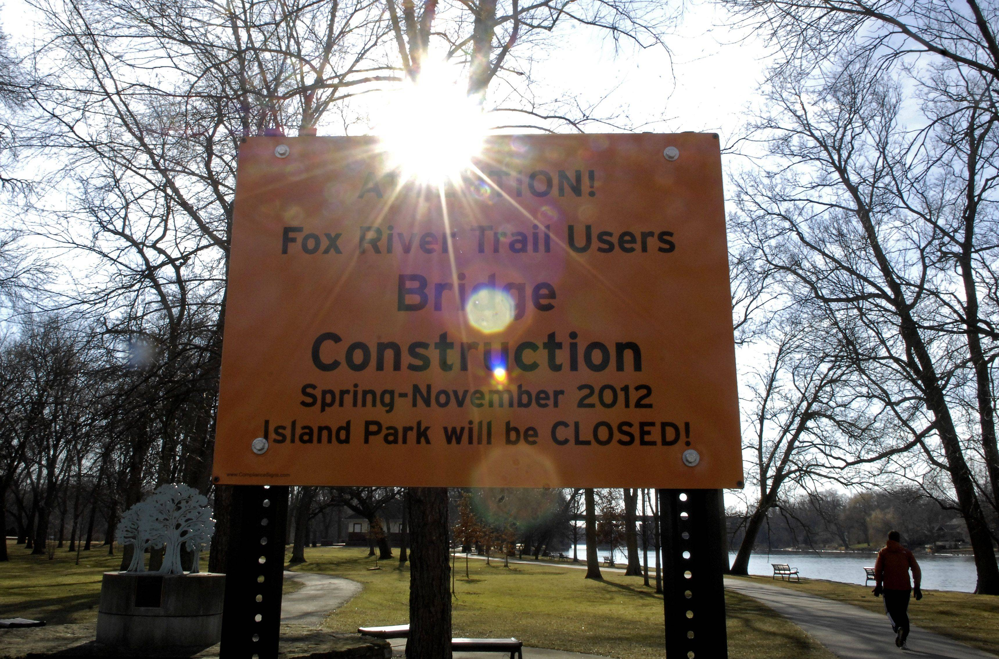A sign in Island Park in Geneva gives notice of an upcoming extended closure this spring. The area will be closed while crews replace the north bridge of the park this year.