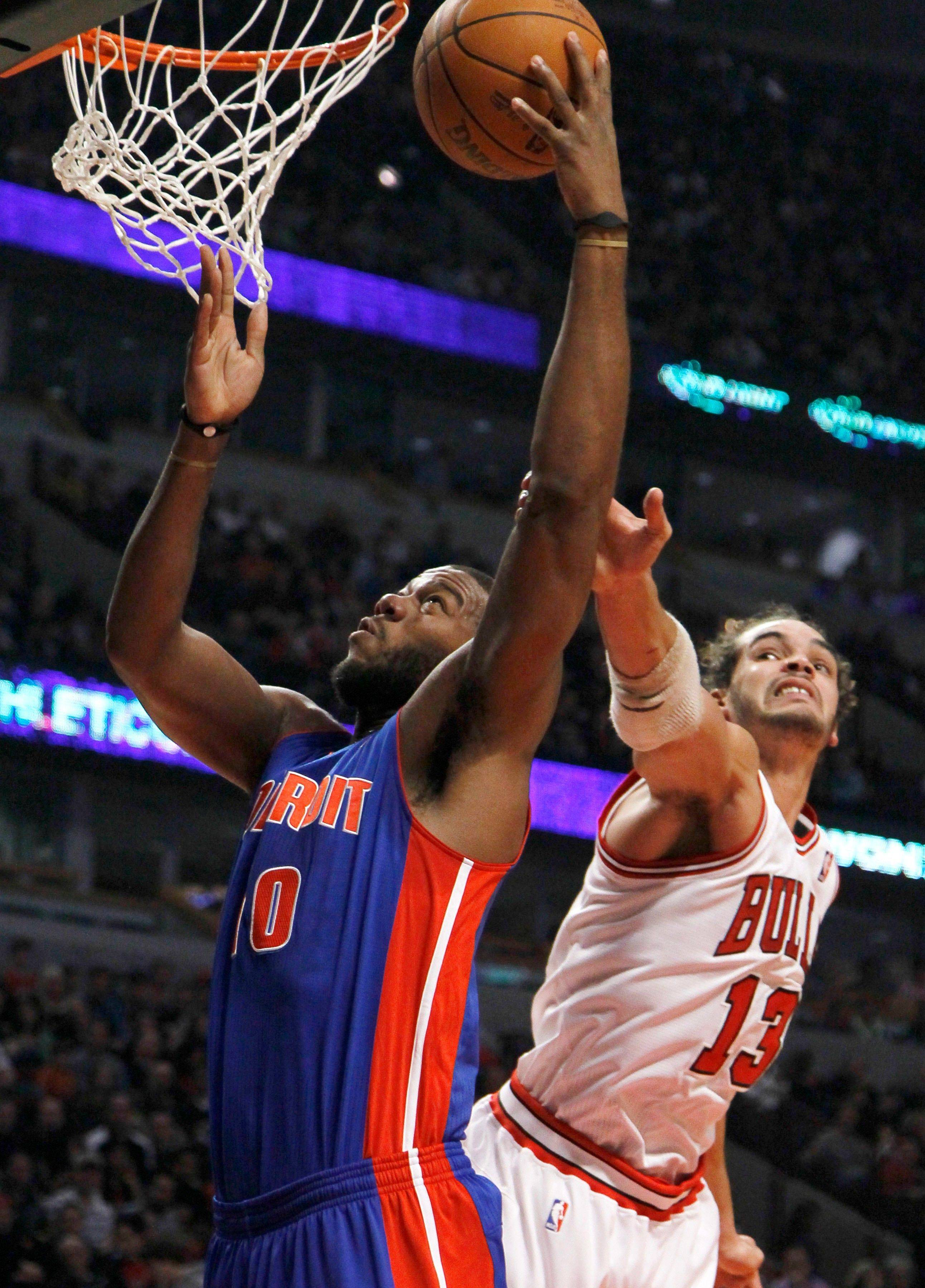 The Bulls' Joakim Noah commits a foul Monday night trying to guard Greg Monroe of the Pistons. The Bulls won 92-68 at the United Center.