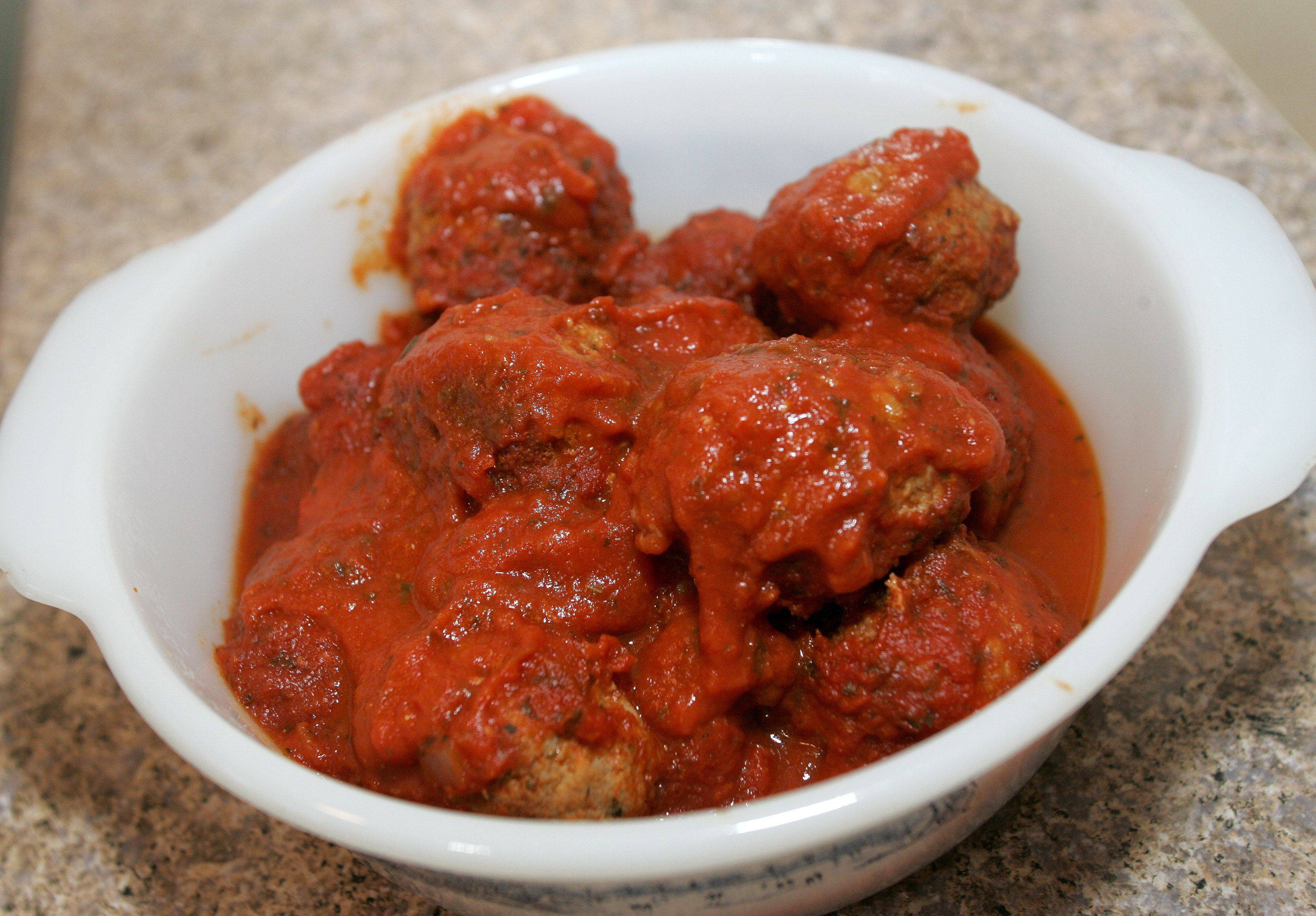After browning her meatballs Mary Lou Salato of Wheaton simmers them in a thick tomato sauce.