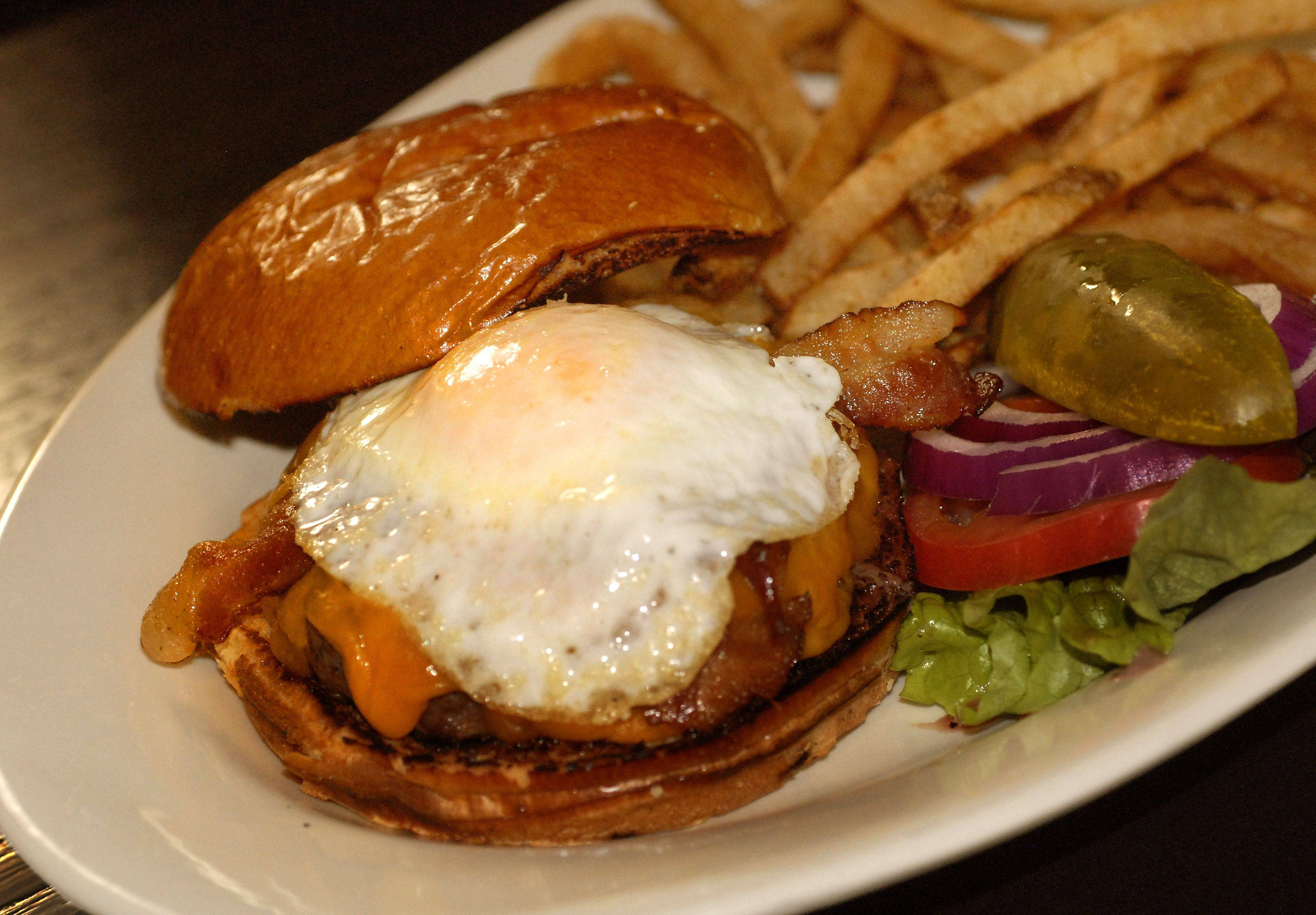 What would a sports bar be without burgers? At Wickets, the options include a half-pounder topped with smoked bacon, cheddar cheese and a fried egg.