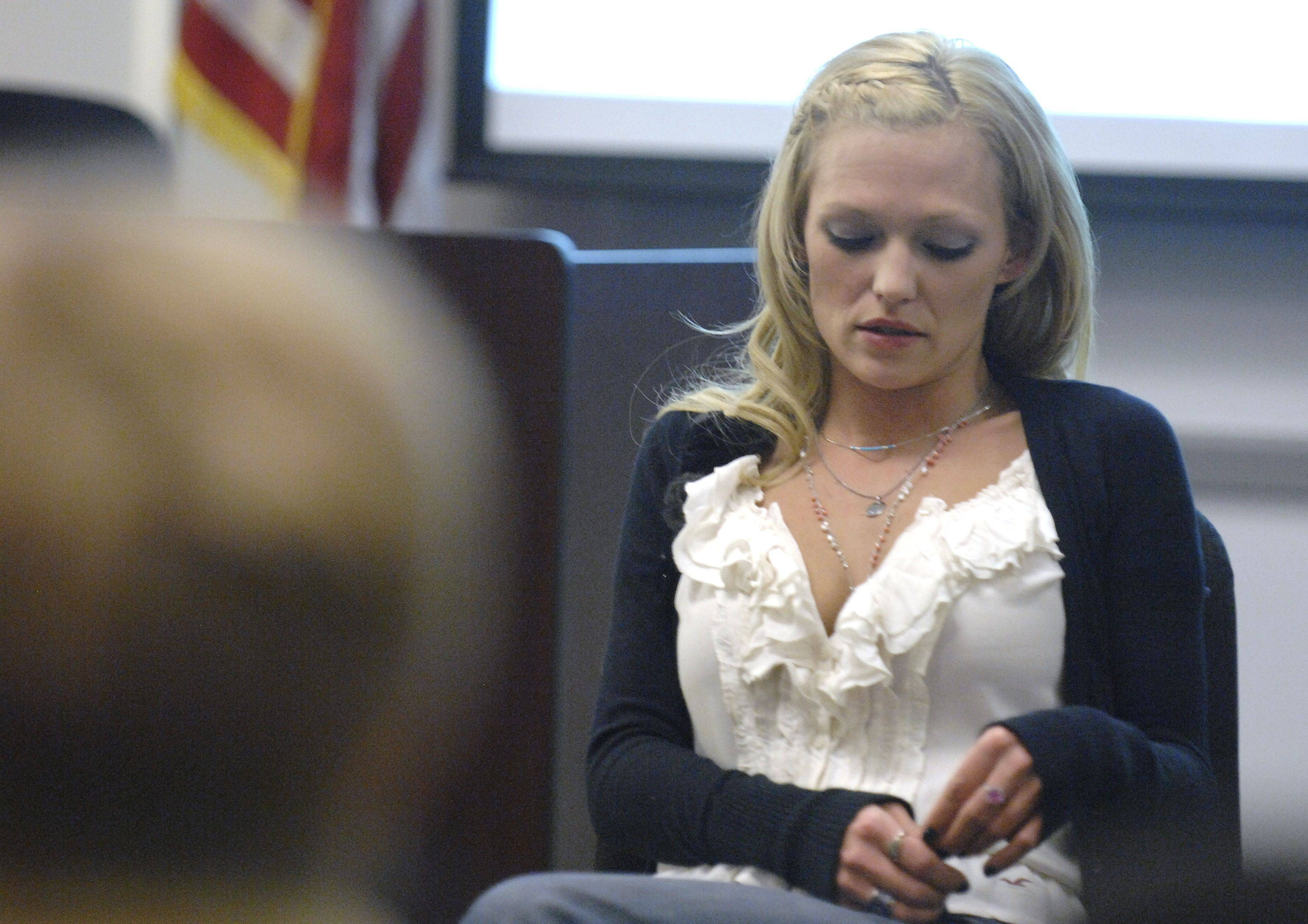 Carrie Brummel of Batavia, who has been clean of her heroin addiction for ten years, tells her story Tuesday at a Kane County Sheriff's drug and alcohol prevention program.