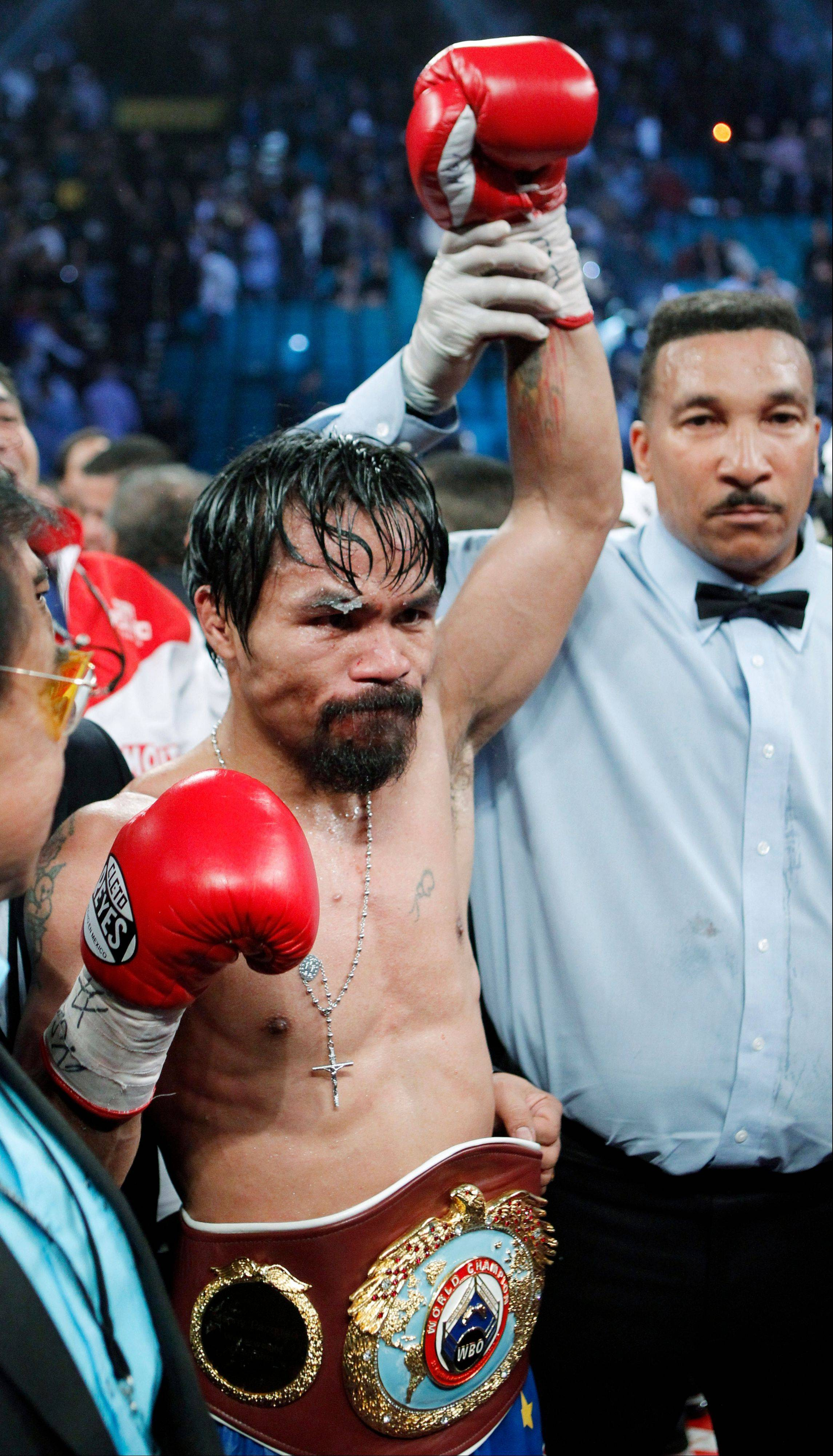 Floyd Mayweather challenged and taunted Manny Pacquiao, shown here after his victory over Juan Manuel Marquez in November, to a May 5 bout in a tweet on Tuesday.