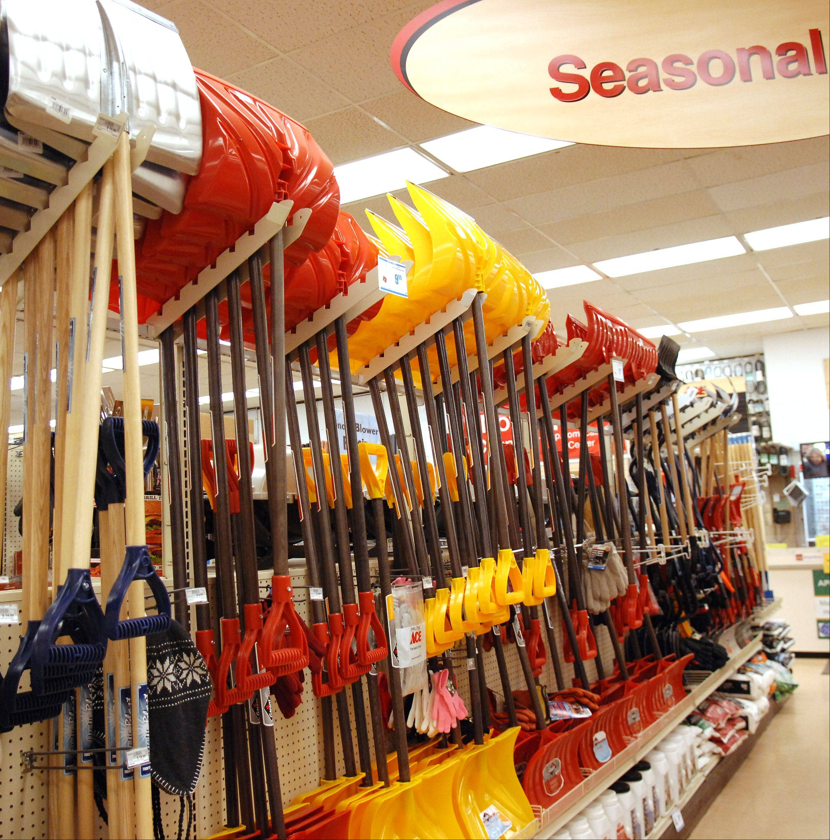 Shovels and ice scrapers are fully stocked at Ace Hardware in Elgin. The mild weather has slowed demand for snow removal items.
