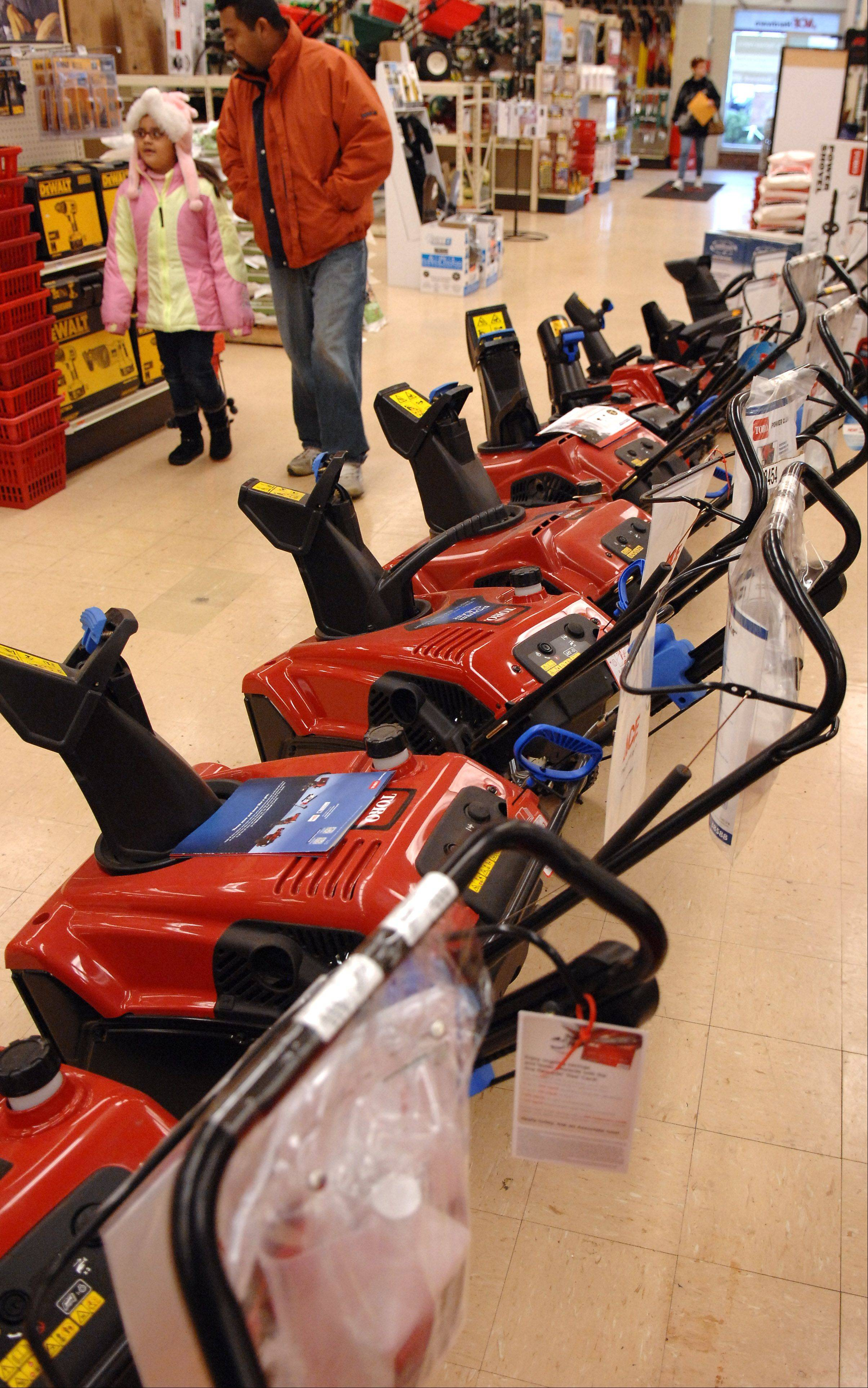 Customers walk past an array of snowblowers and throwers without a second glance Monday at Ace Hardware in Elgin.