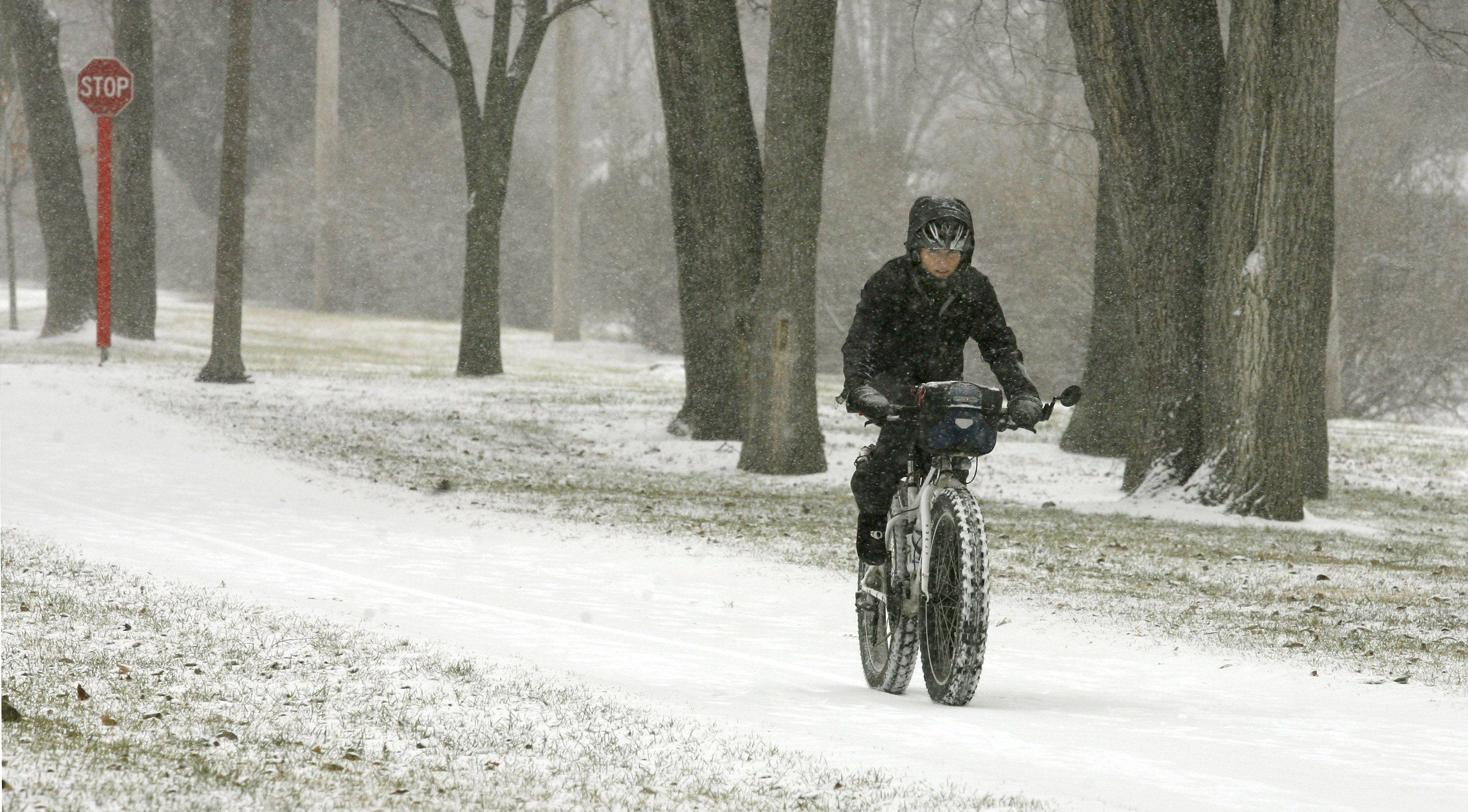 A lone bicycle rider makes her way east along the Illinois Prairie Path through Villa Park.