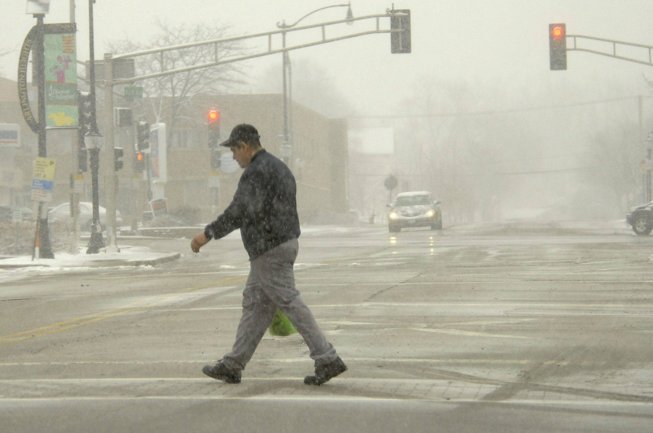 Conditions were still not too bad for pedestrians as the temperature hovered around 30 degrees on Vail Avenue just south of the Metra tracks Thursday afternoon in Arlington Heights.