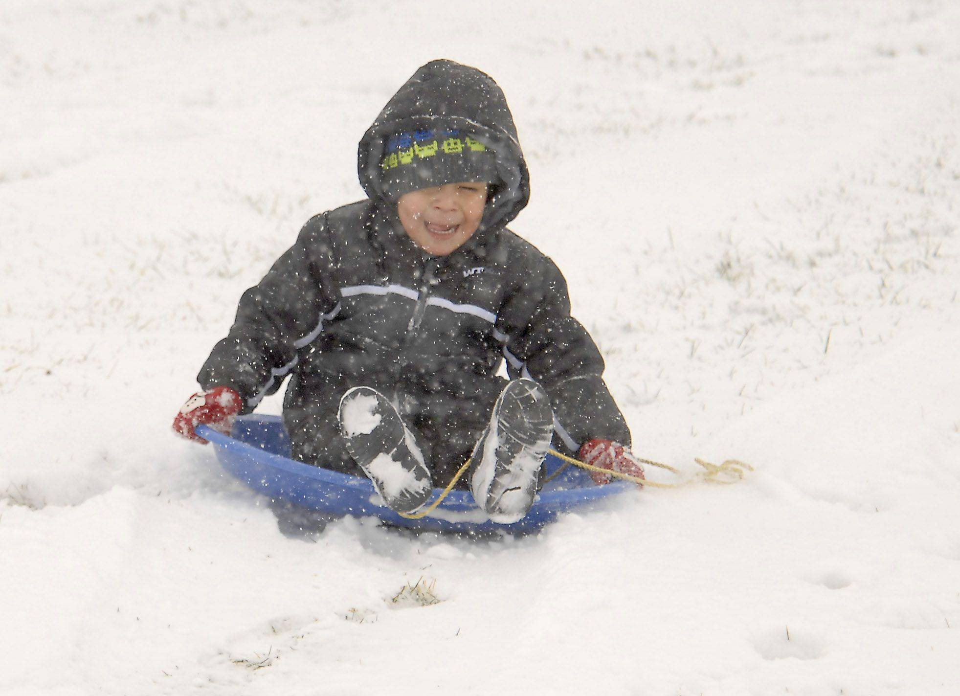 Eric Marron, 3, of Rolling Meadows gets his first crack at sledding this winter Thursday afternoon at Sunset Meadows Park in Arlington Heights.