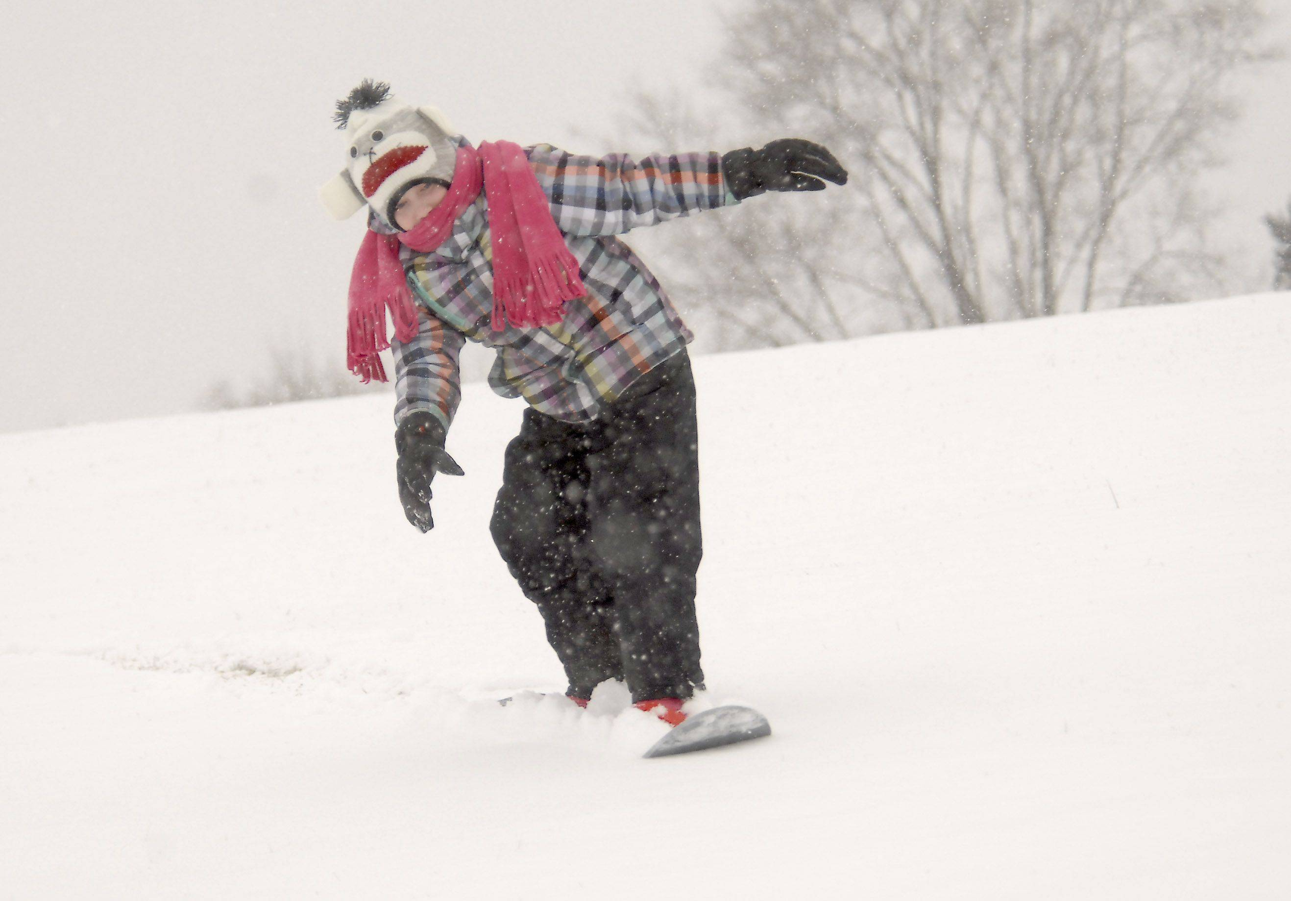 Karli Ryan, 10, of Hoffman Estates plays in the snow on Thursday afternoon.