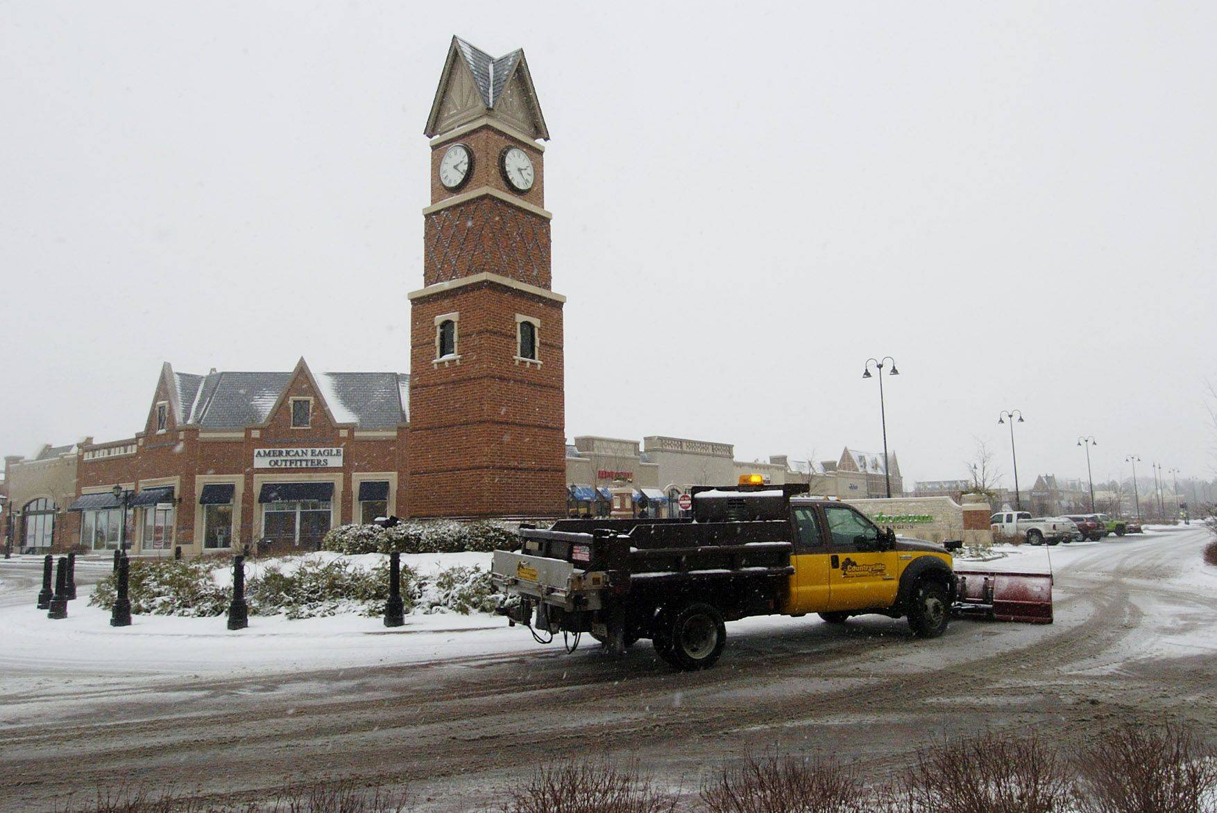 What a difference a day makes, as snow plows go to work at The Arboretum in South Barrington.