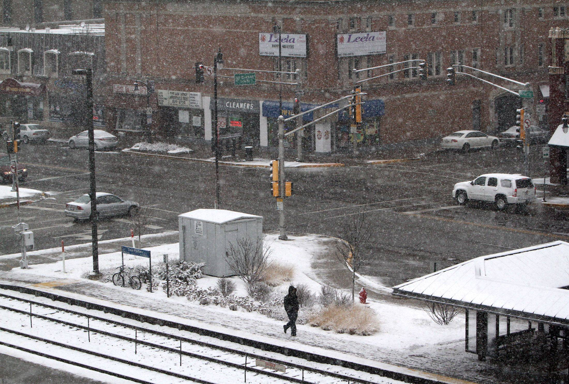 A view of intersection of Northwest Highway and Lee Street from the third floor of the Des Plaines Library during the late-arriving first snow storm of the season.