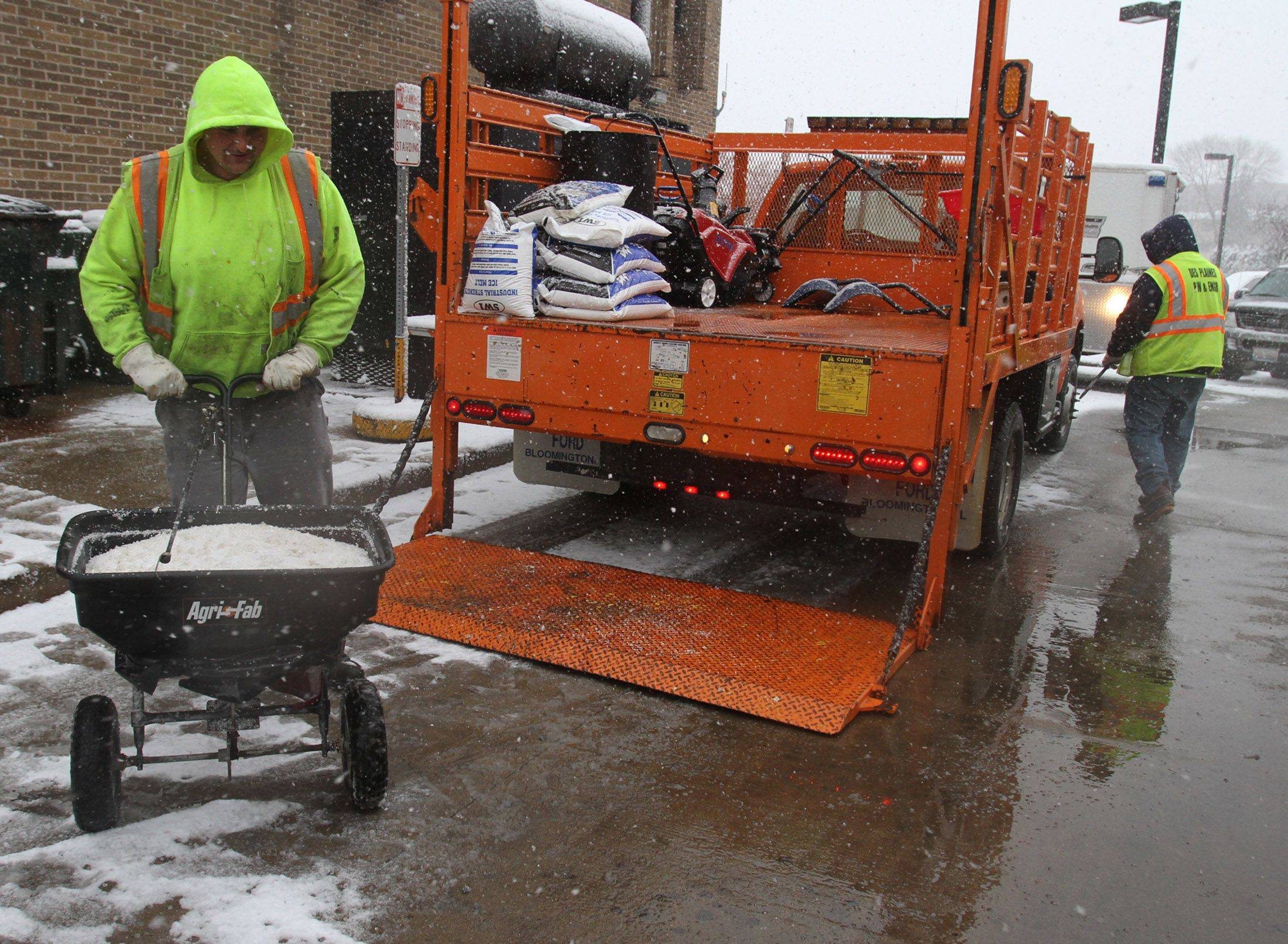 Andy Stiava with Des Plaines Public Works and Engineering Department salts behind City of Des Plaines Civic Center .