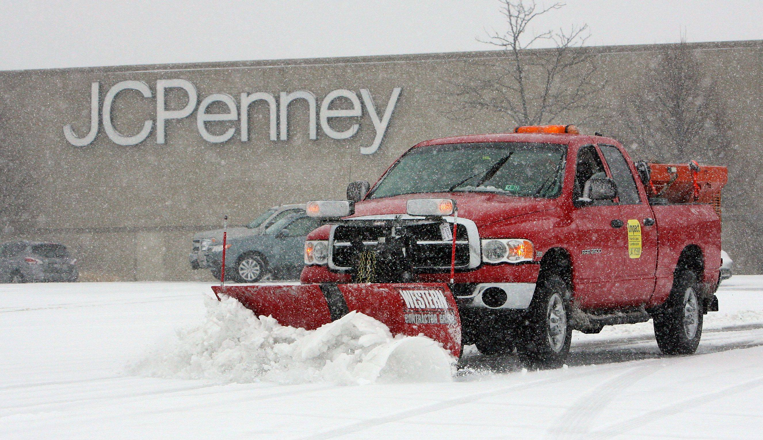 A truck plows the parking lot in front of JCPenney at Westfield Hawthorn mall in Vernon Hills.