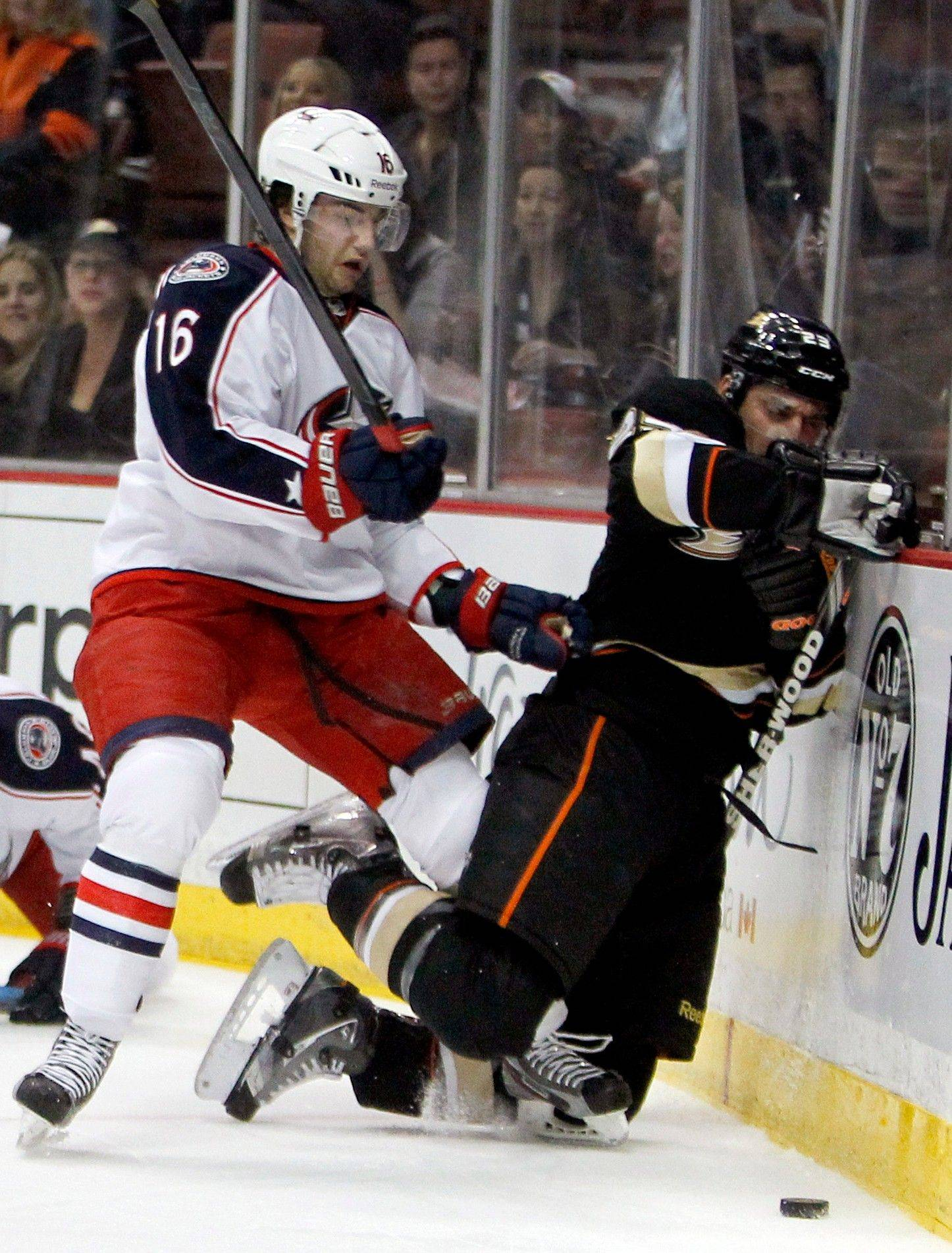 Columbus Blue Jackets center Derick Brassard hits Anaheim Ducks defenseman Francois Beauchemin into the boards Sunday during the first period.