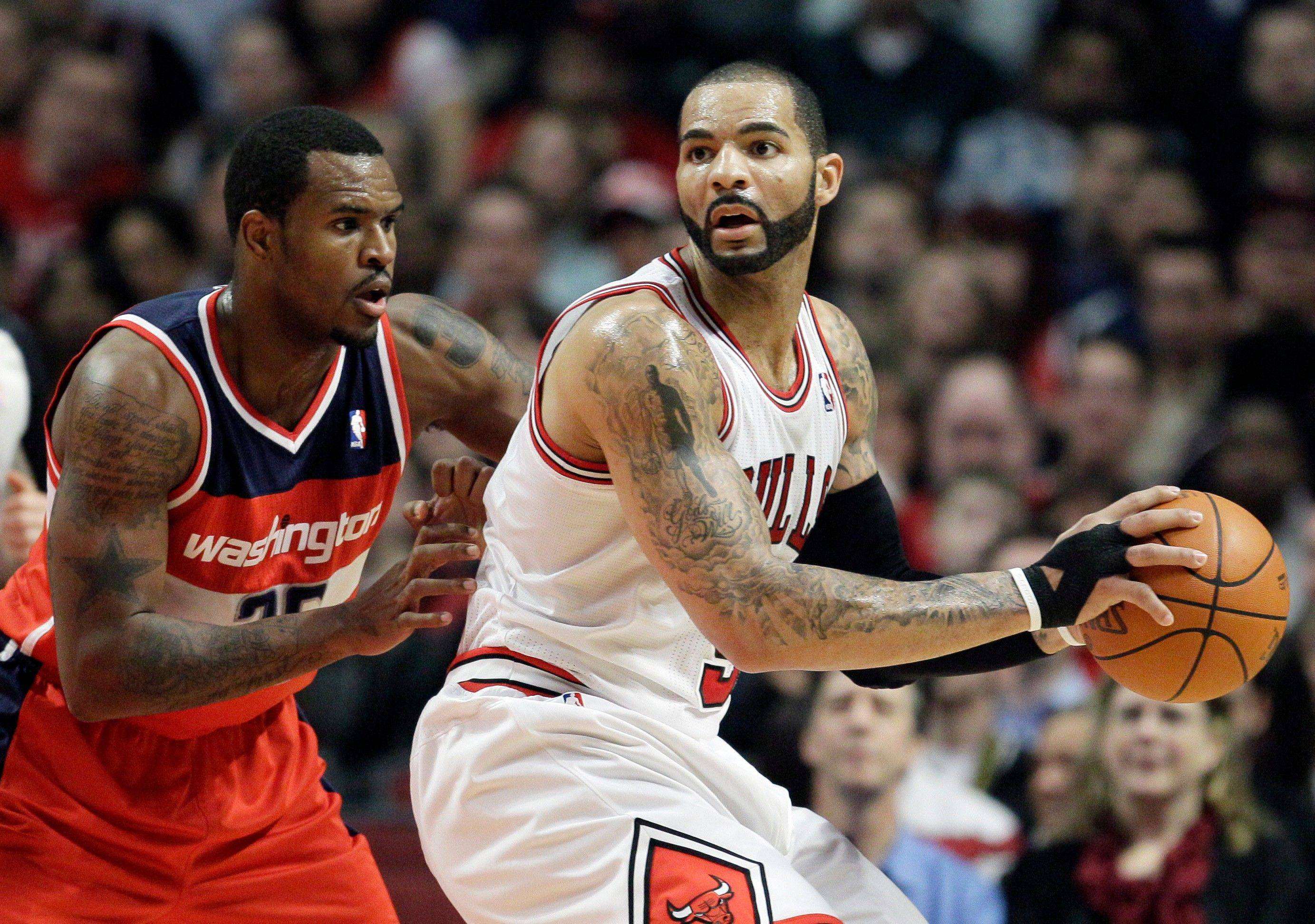 Carlos Boozer didn't play a second in the fourth quarter of the Bulls' win over Washington on Wednesday. This has been a hot topic around town, but coach Tom Thibodeau said he thought he could win the game with defense, which is why Taj Gibson and Omer Asik were on the floor.