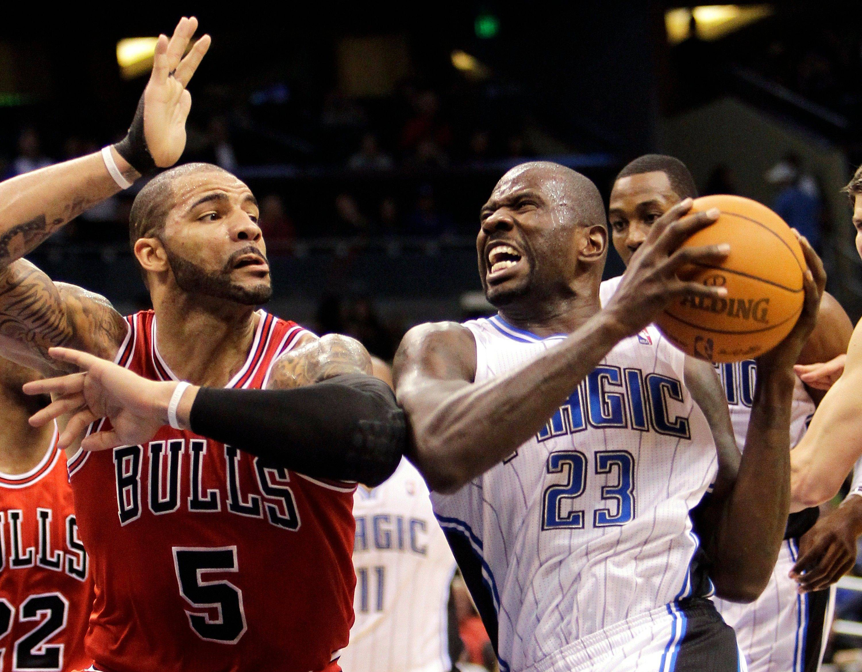 The Orlando Magic's Jason Richardson tries to make his way to the basket past the Bulls' Carlos Boozer earlier this season.