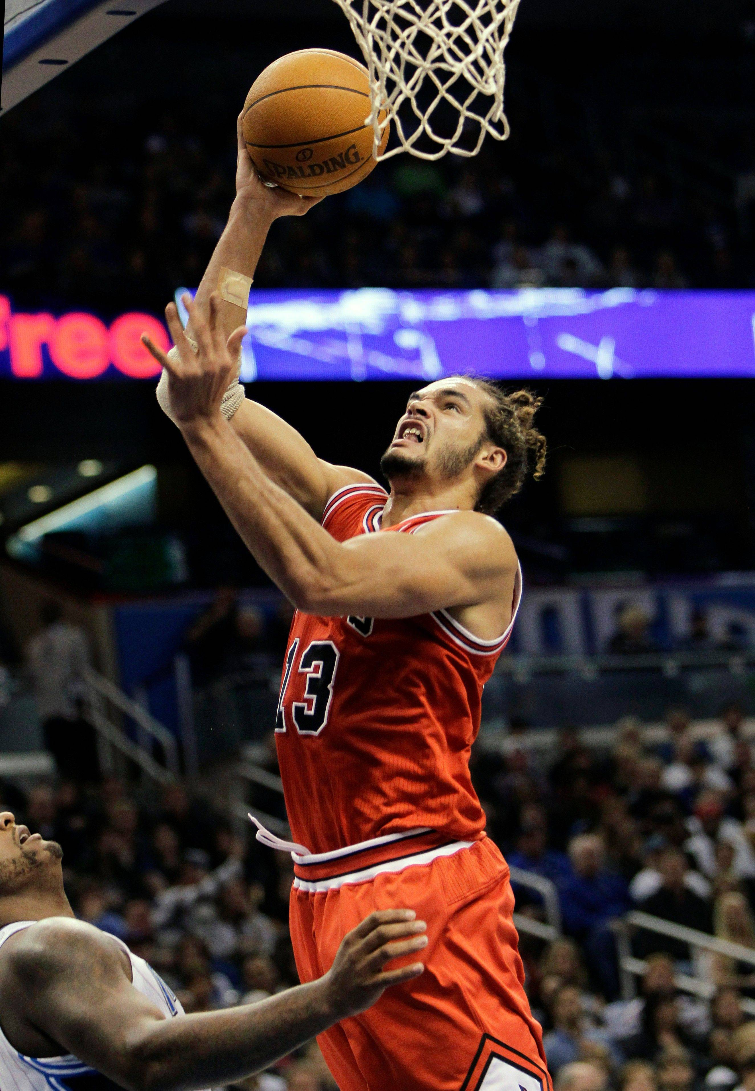 The Bulls' Joakim Noah shoots over Orlando Magic's Glen Davis, left, earlier this season.