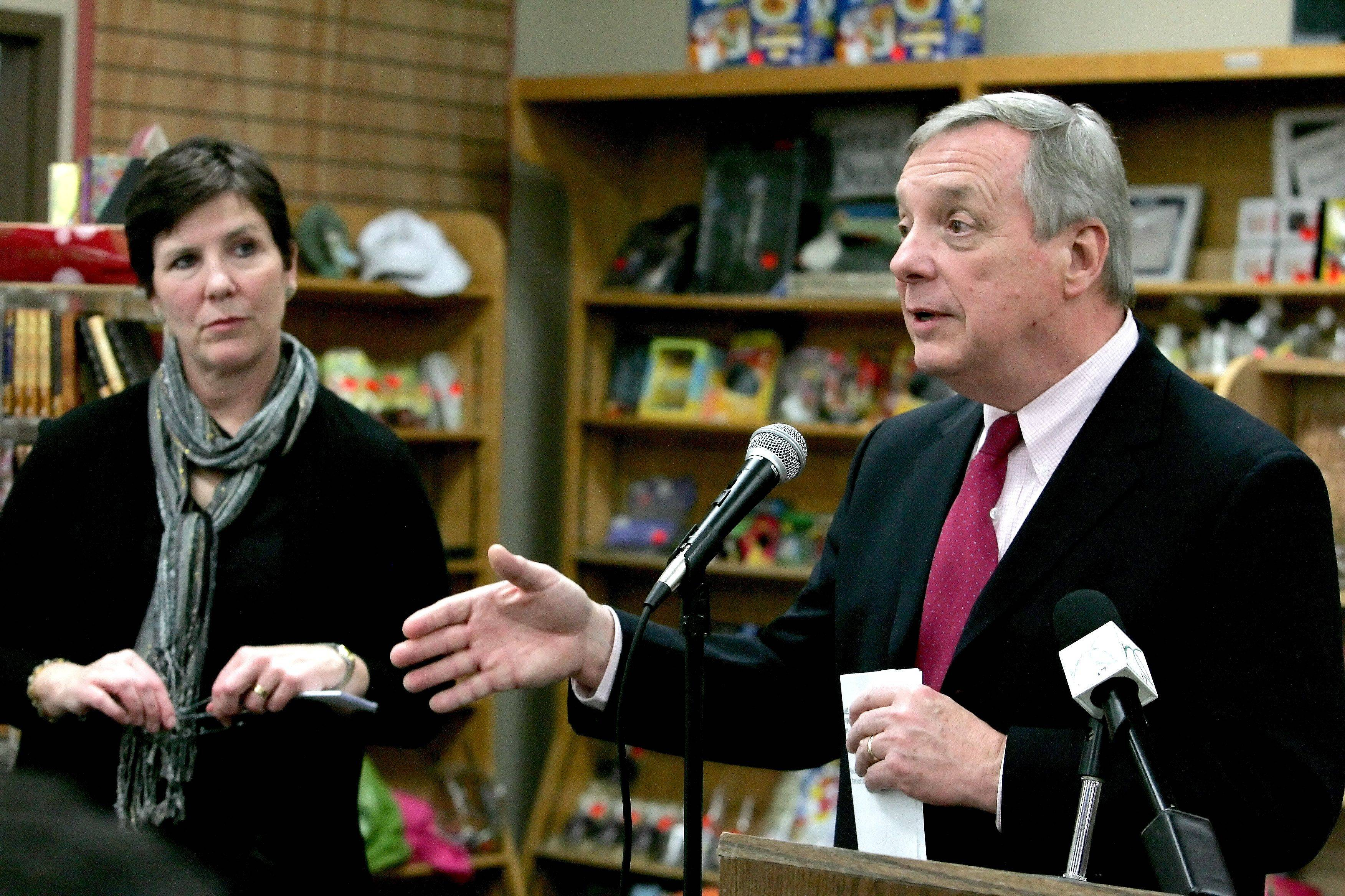 "Becky Anderson, co-owner of Anderson's Bookshop in downtown Naperville, listens as U.S. Sen. Dick Durbin speaks Friday about the Marketplace Fairness Act. The proposal aims to level the playing field between online and ""bricks and mortar"" merchants by allowing states to require online retailers to collect sales tax."