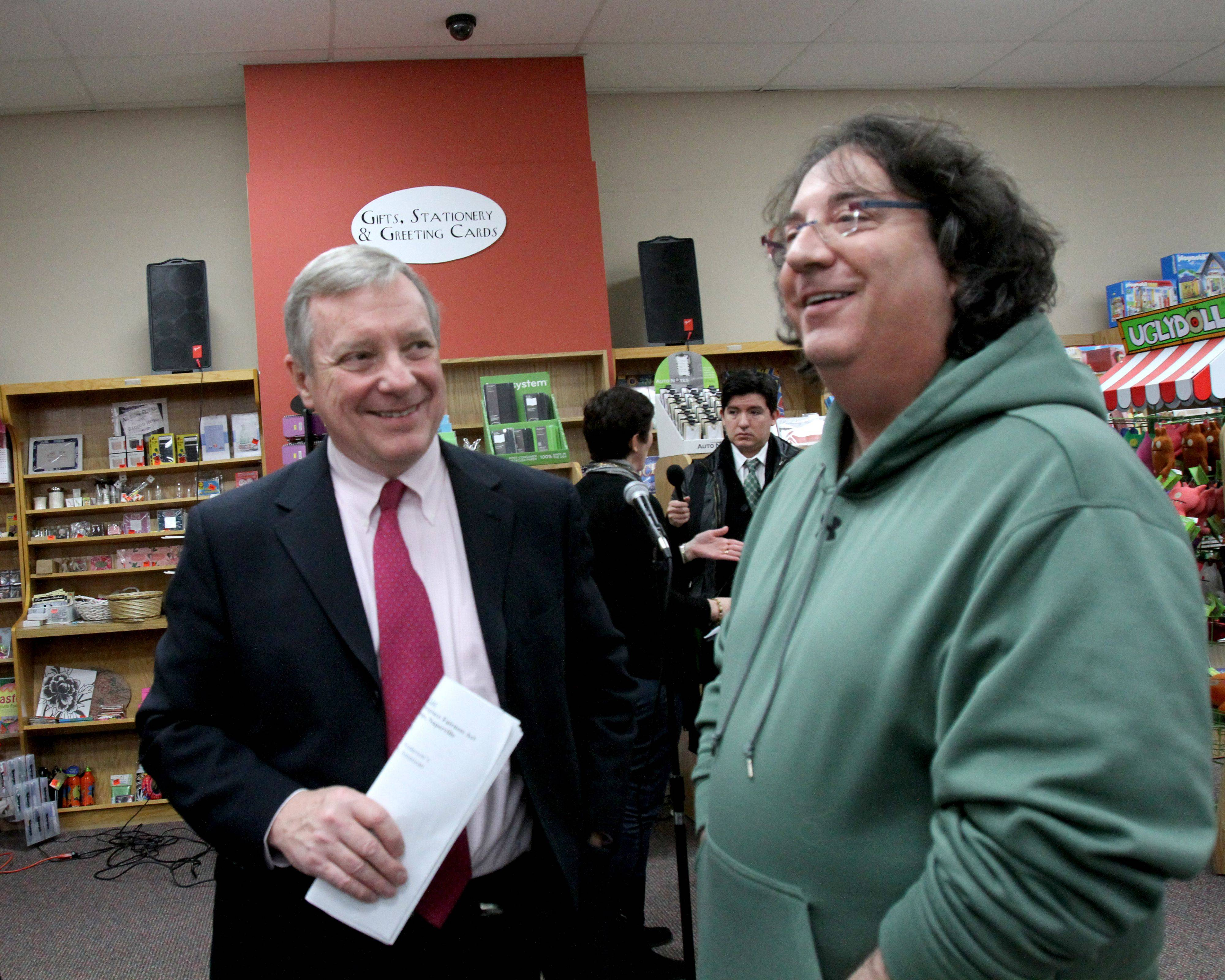 U.S. Sen. Dick Durbin speaks with Greg Gordan, owner of Dog Patch Pet & Feed in Naperville, on Friday at Anderson's Bookshop in downtown Naperville. Durbin told small business owners support is building for the Marketplace Fairness Act, which would close an online sales tax loophole.