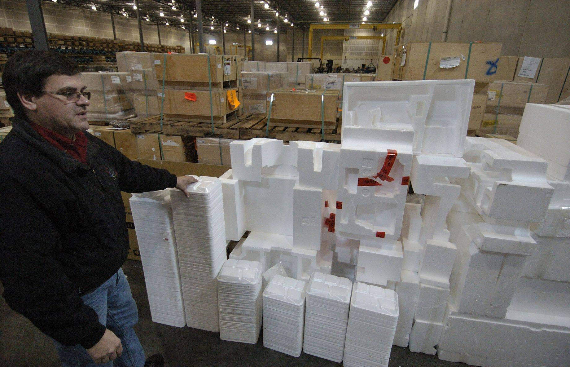 Ken Santowski looks over a pile of packing foam along with foam lunch trays from Abbott Middle School in Elgin.