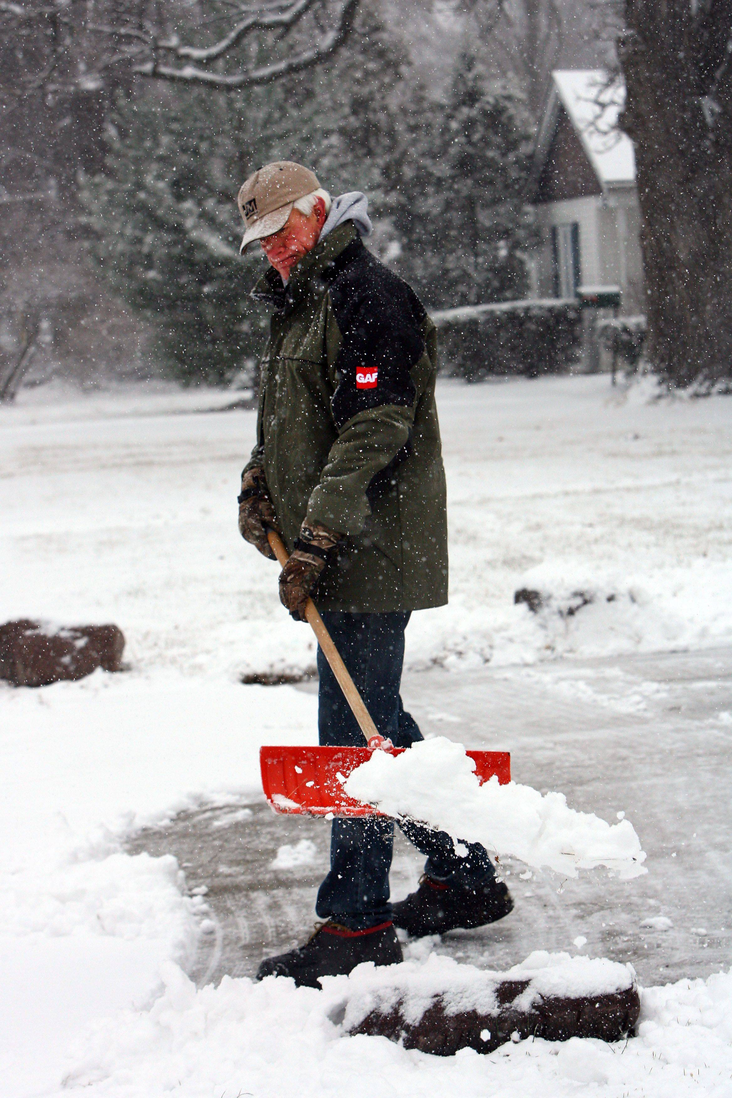 Mike Lahey shovels his driveway in Mundelein on Thursday.