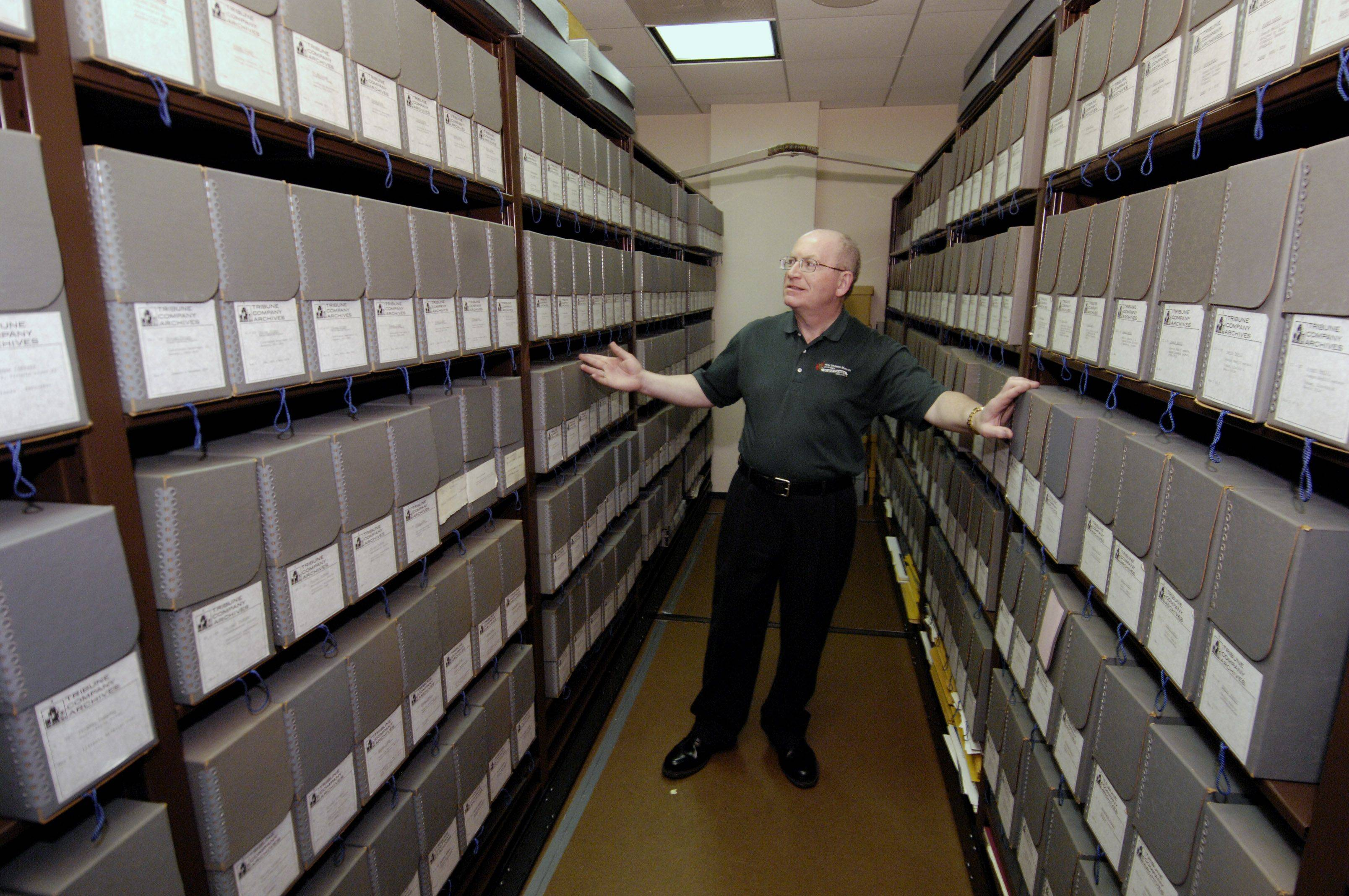 Eric Gillespie shows off some of the boxes containing the McCormick papers, that are under lock and key, in the Colonel Robert R. McCormick Research Center.