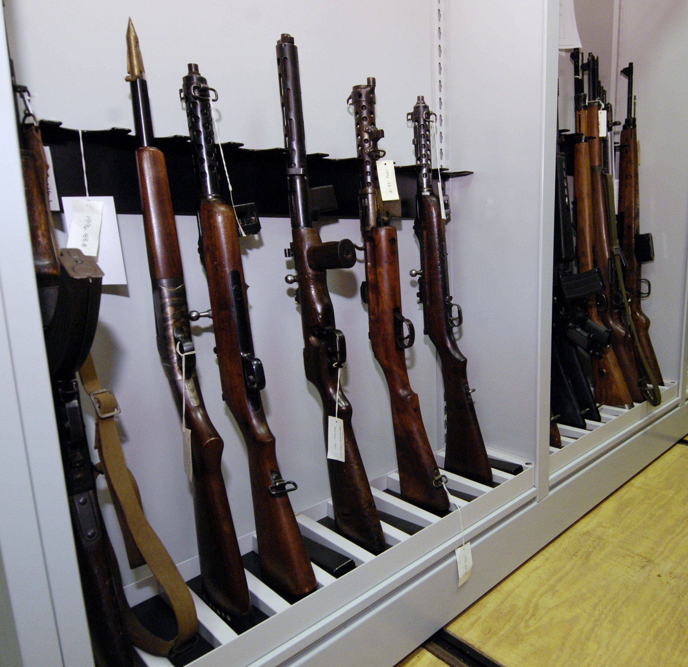 Items such as these rifles and machine guns are housed in a vault along with other items such as artwork and other weapons in the 1st Division Museums collections area.