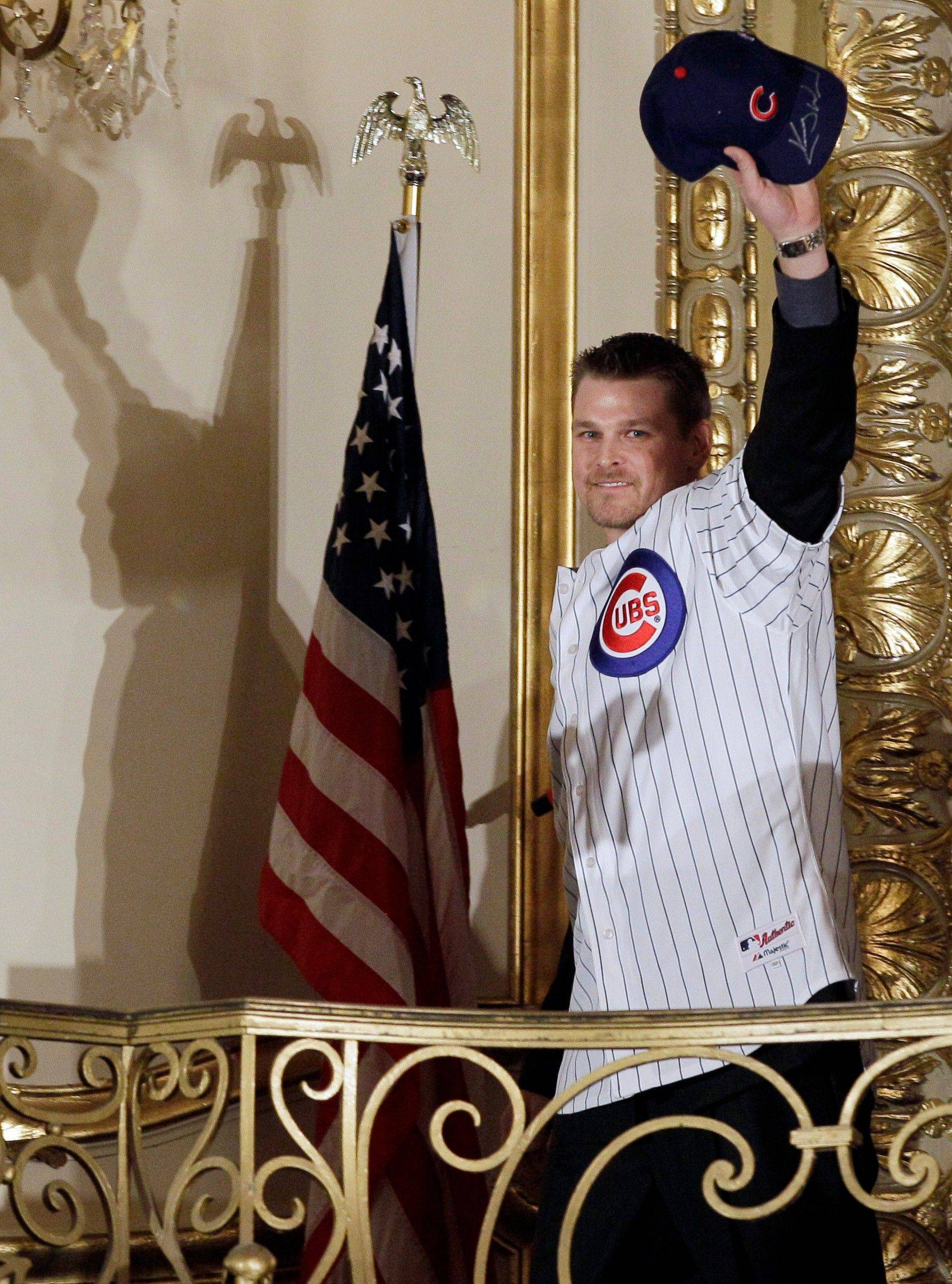 Kerry Wood waves to fans during player introductions at the 27th Annual Cubs Convention in Chicago on Friday. Wood signed a one-year deal worth $3 million to return to the North Side next season.