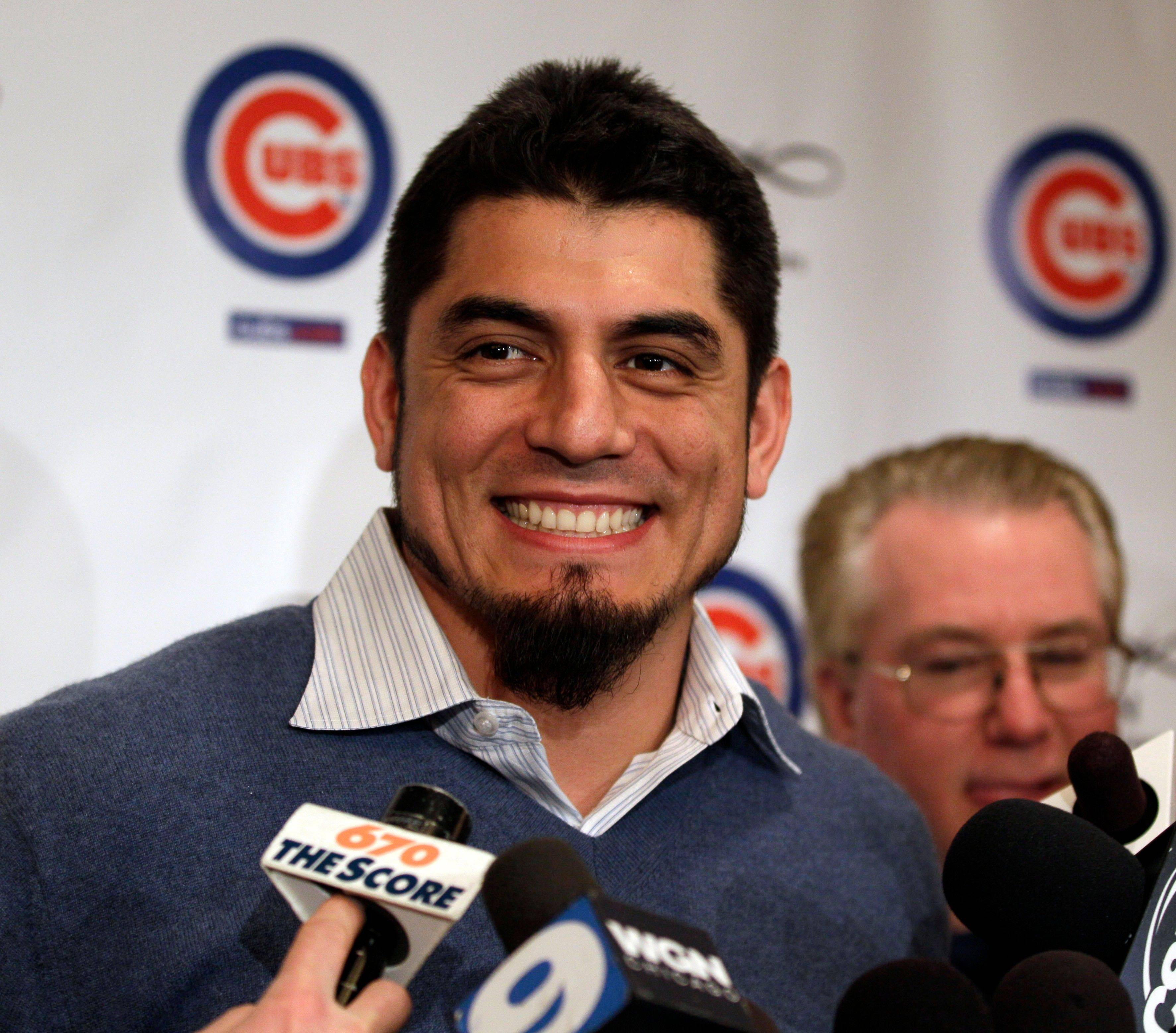Chicago Cubs pitcher Matt Garza speaks to reporters during the 27th annual Chicago Cubs baseball convention in Chicago on Friday, Jan. 13, 2012.
