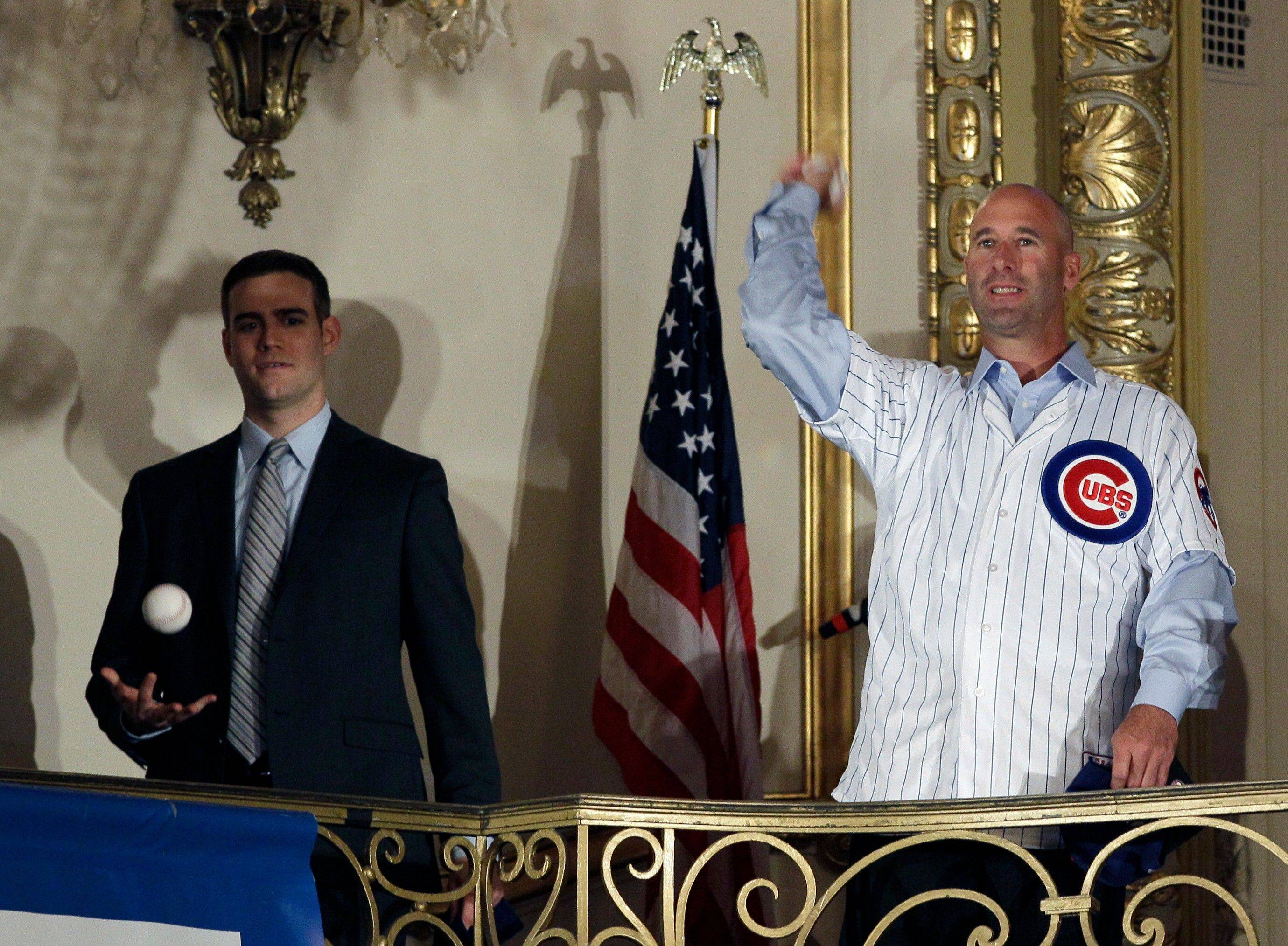 Chicago Cubs new manager Dale Sveum, right, throws out a ceremonial first pitch as Theo Epstein, president of baseball operations, plays with a ball during the 27th Annual Chicago Cubs Convention in Chicago on Friday, Jan. 13, 2012.