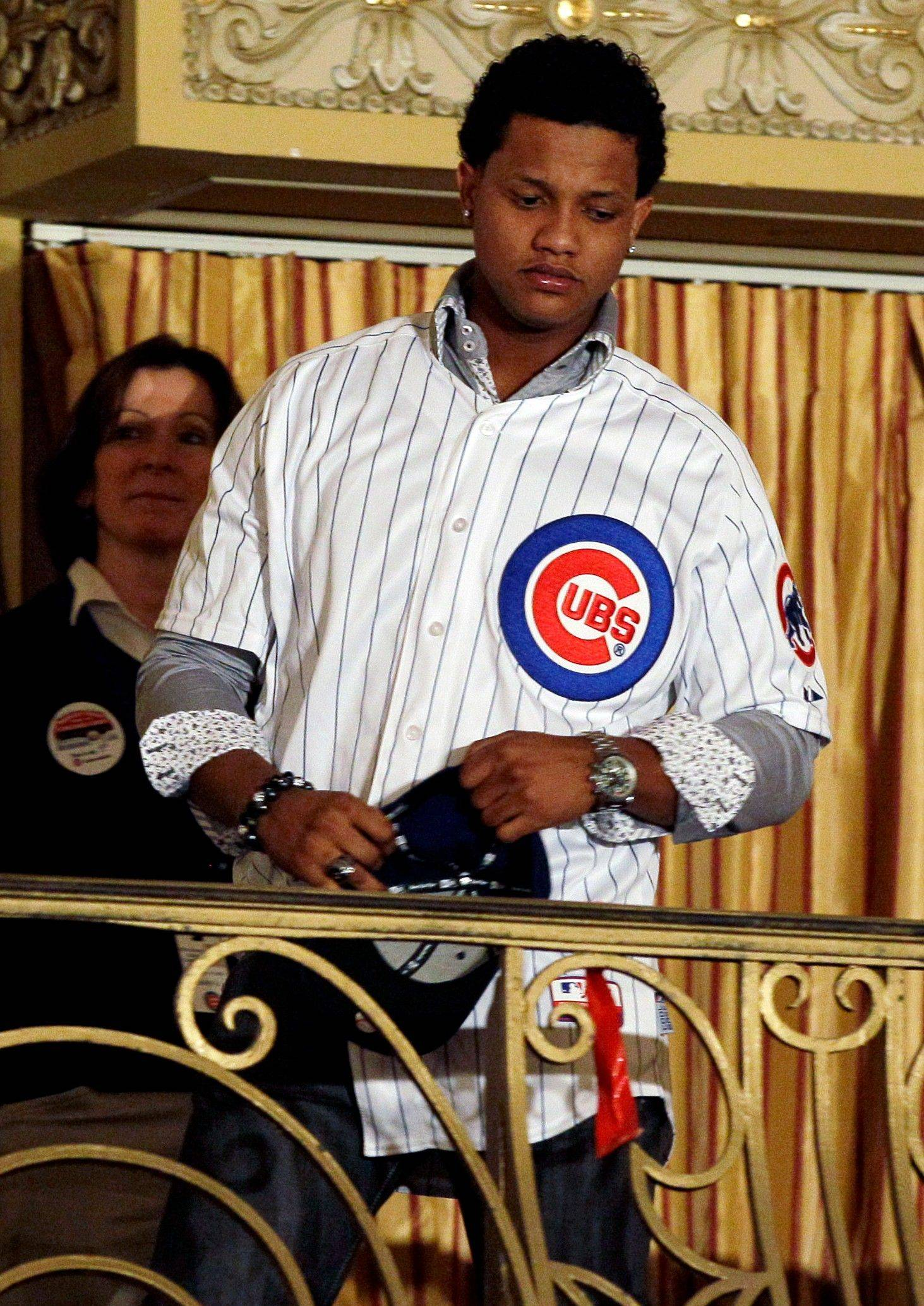 Chicago Cubs infielder Starlin Castro looks down during the 27th Annual Chicago Cubs Convention in Chicago on Friday, Jan. 13, 2012.