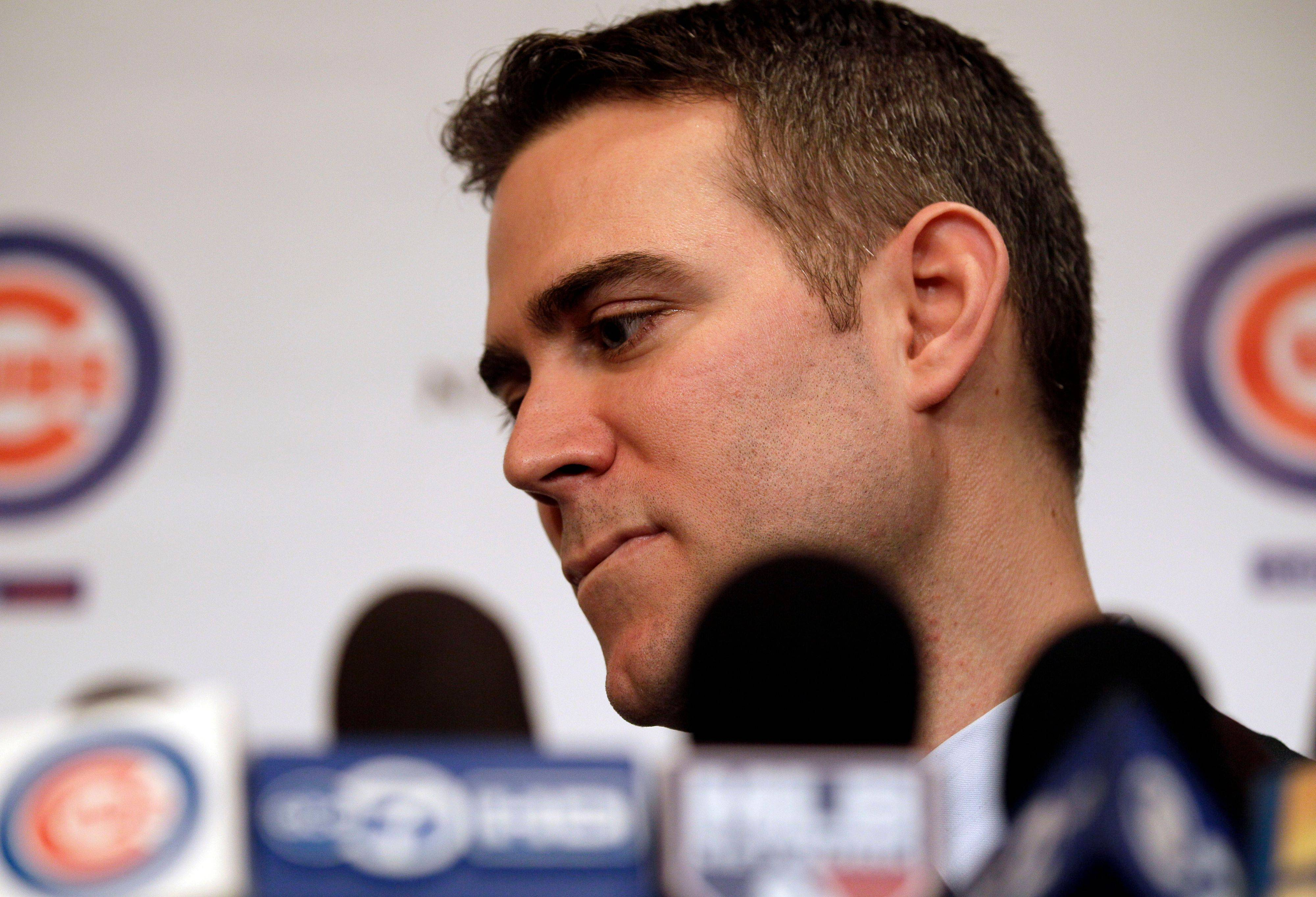 Chicago Cubs president Theo Epstein listens to questions from reporters during a news conference during the 27th annual Chicago Cubs baseball convention in Chicago on Friday, Jan. 13, 2012.