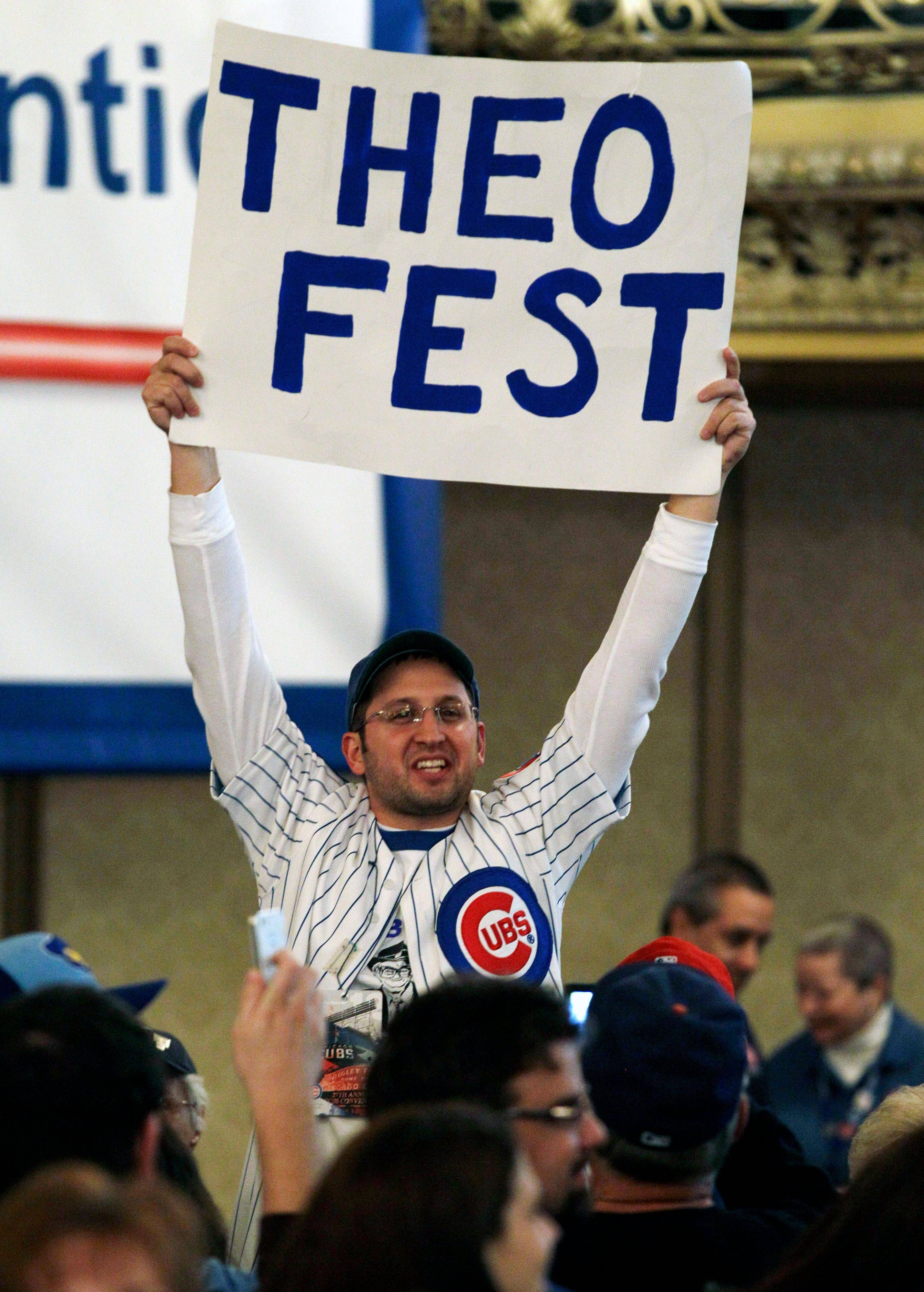 A Chicago Fan holds a sign during the 27th Annual Chicago Cubs Convention in Chicago on Friday, Jan. 13, 2012.